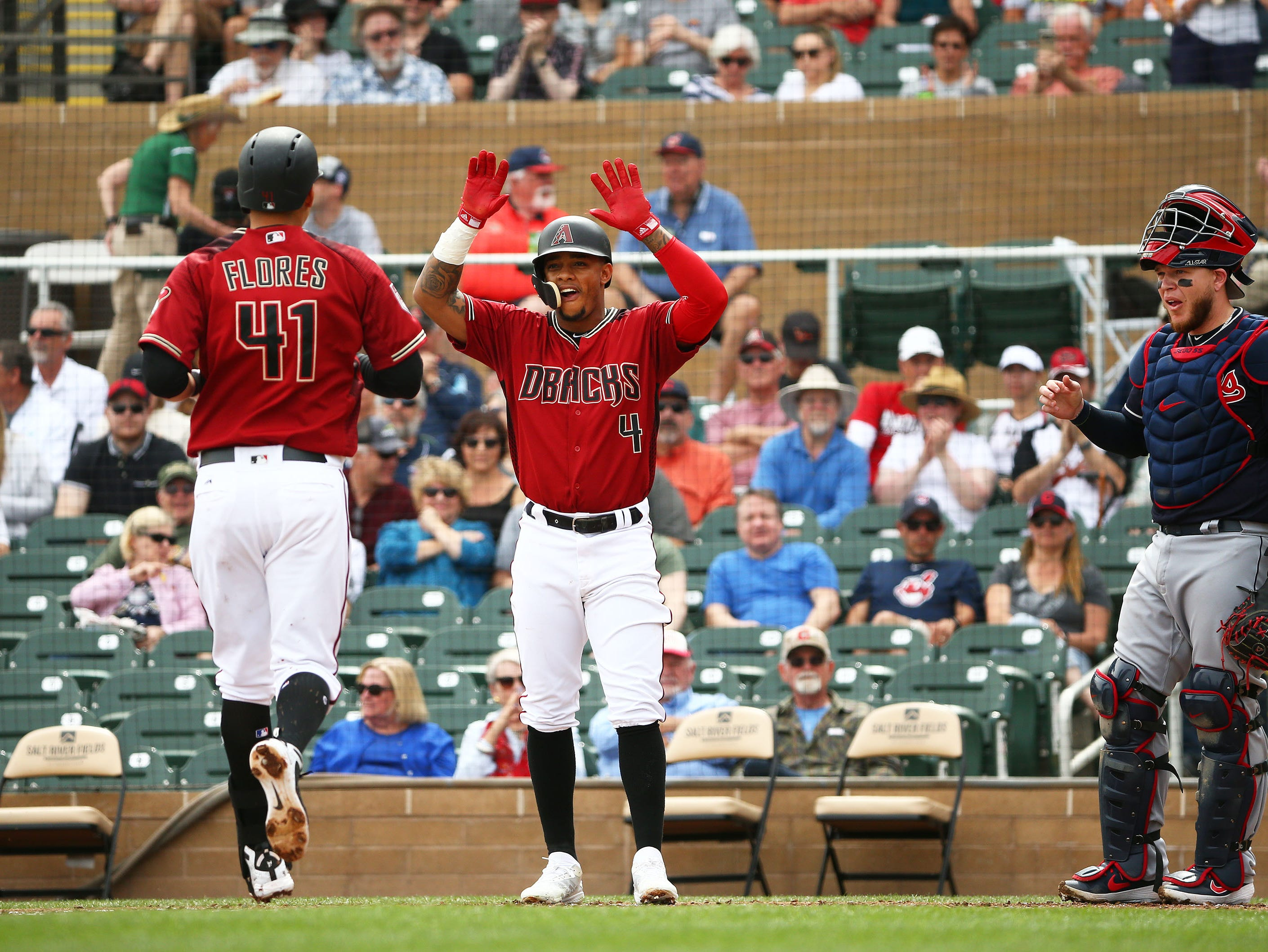 Arizona Diamondbacks Wilmer Flores (41) scores after hitting a two-run home run against the Cleveland Indians in the 1st inning during a spring training game on Mar. 7, 2019 at Salt River Fields in Scottsdale, Ariz.