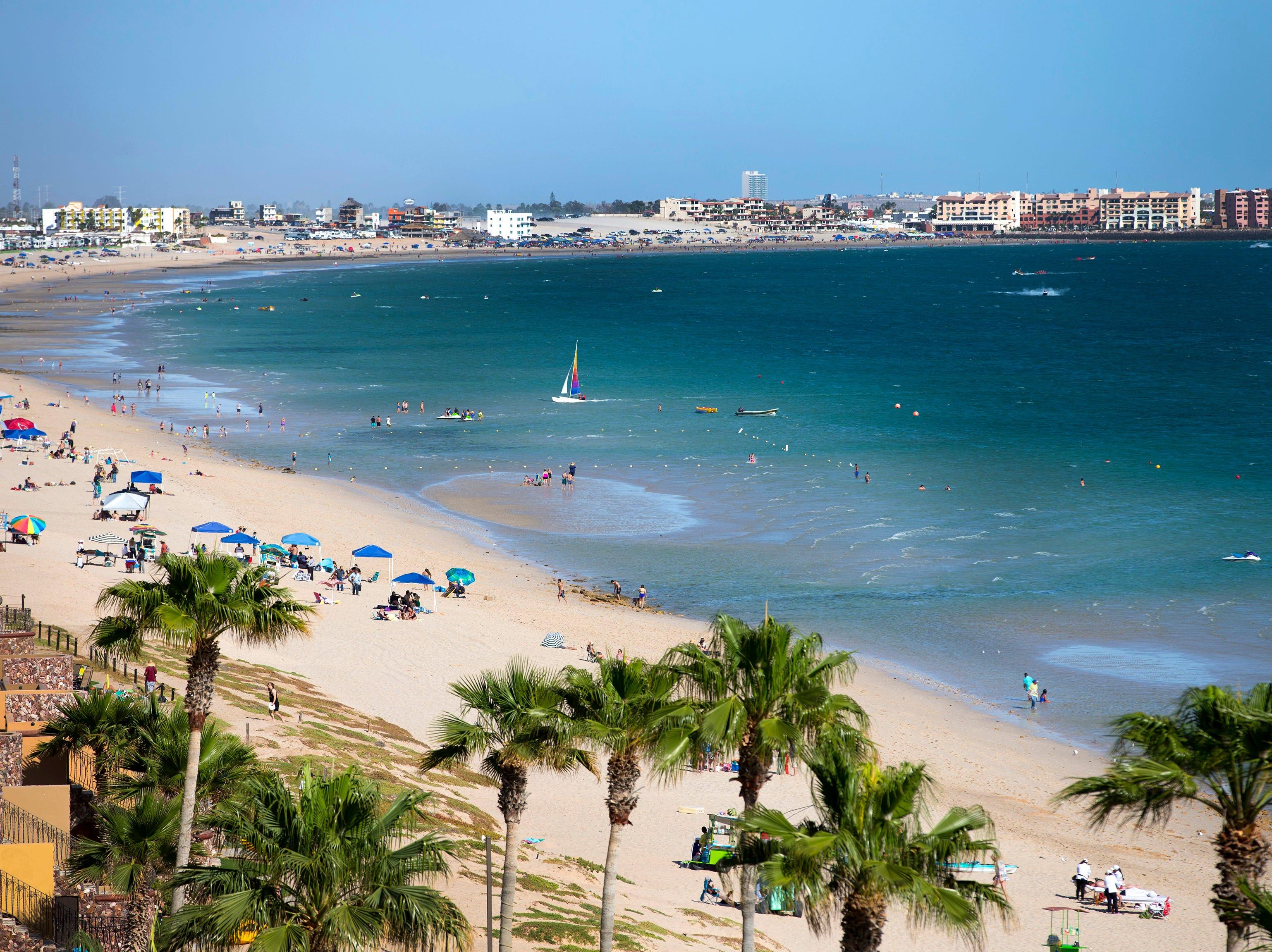 Visitors enjoy a Saturday on Sandy Beach in Puerto Penasco, Mexico.