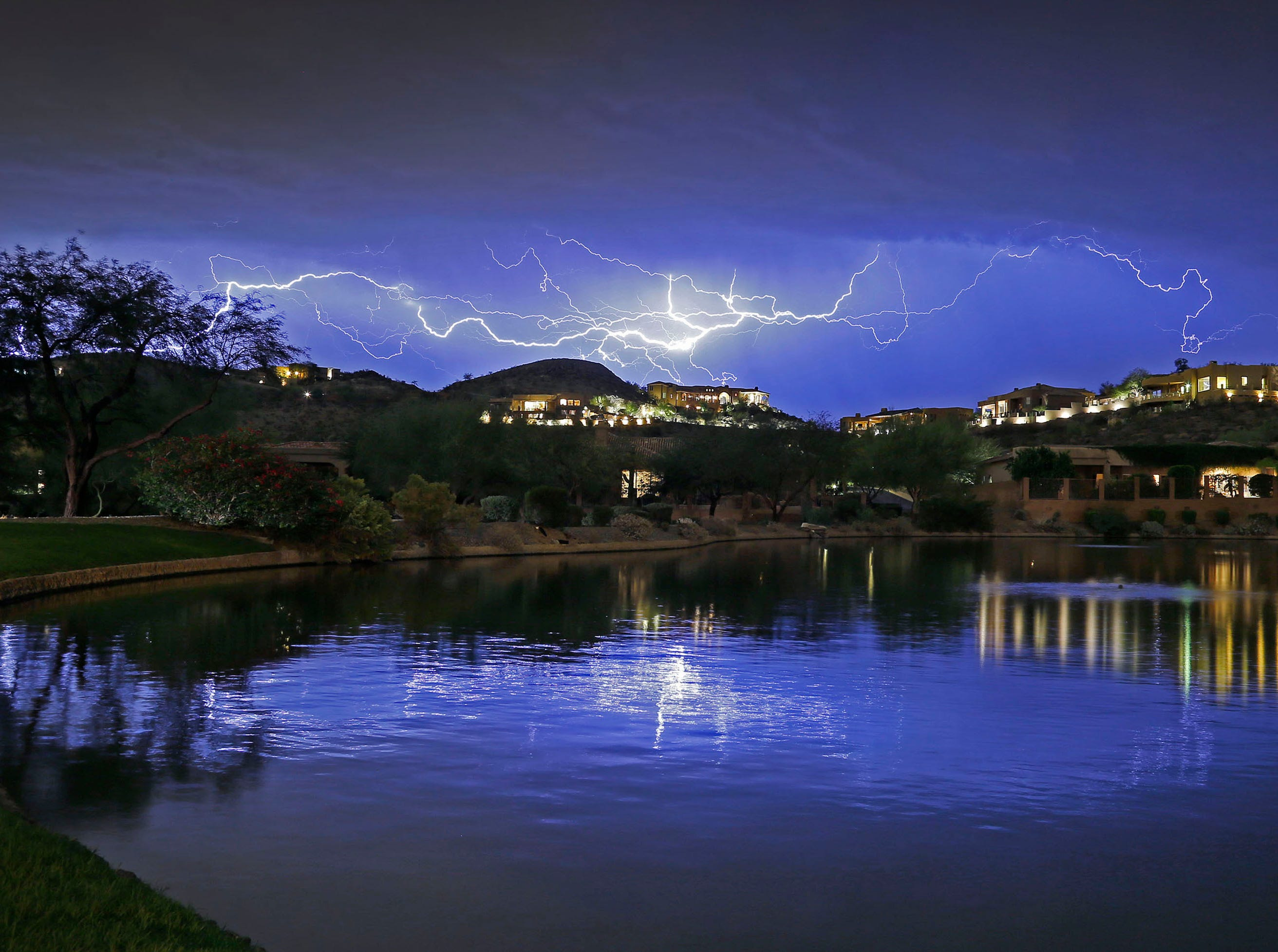 Intracloud Lightning streaks across the night sky as seen from Ahwatukee Thursday, Oct. 29, 2015 in Phoenix, Ariz.