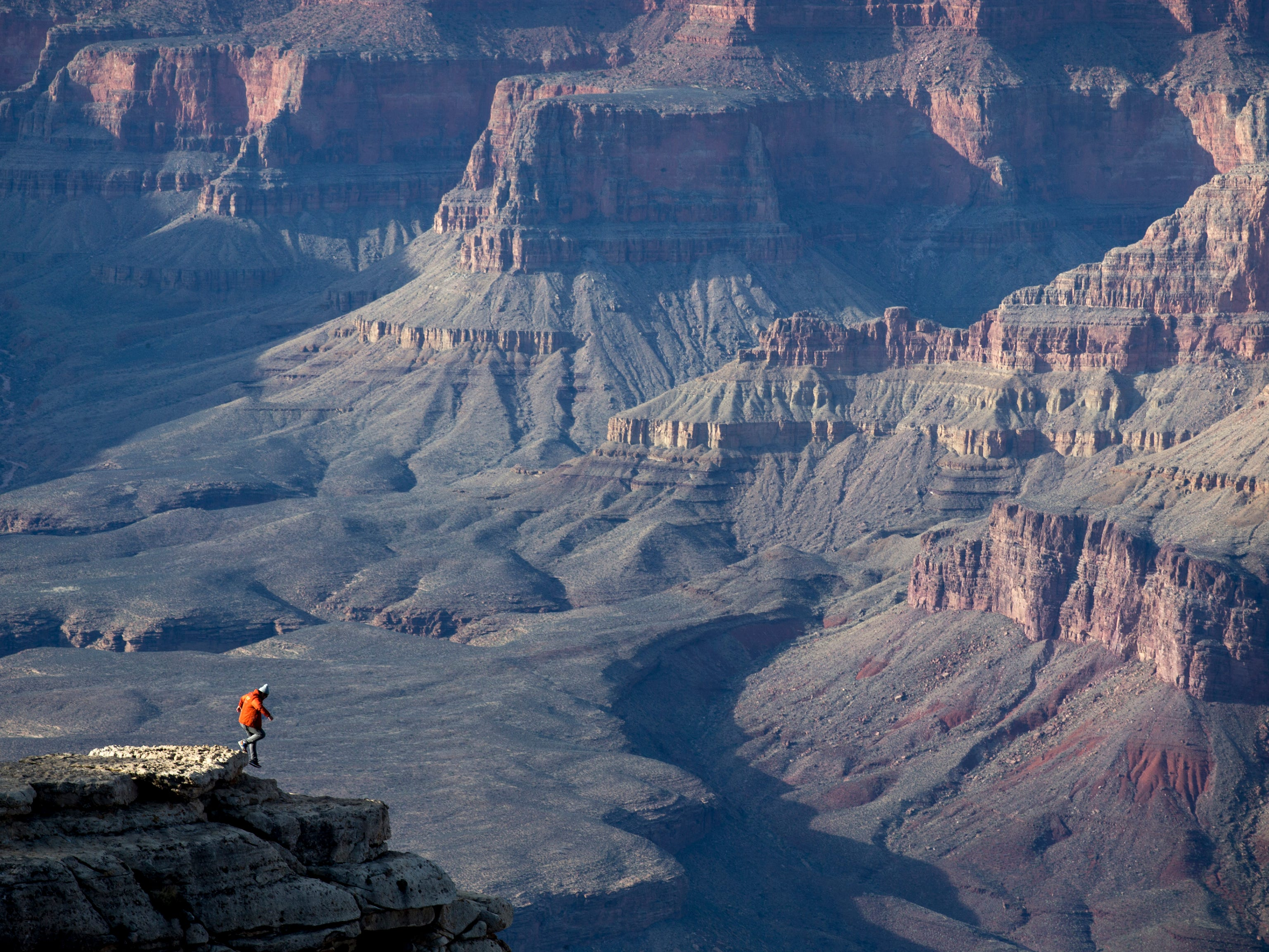 A hiker enjoys Mather Point in the Grand Canyon on Feb. 17, 2016.