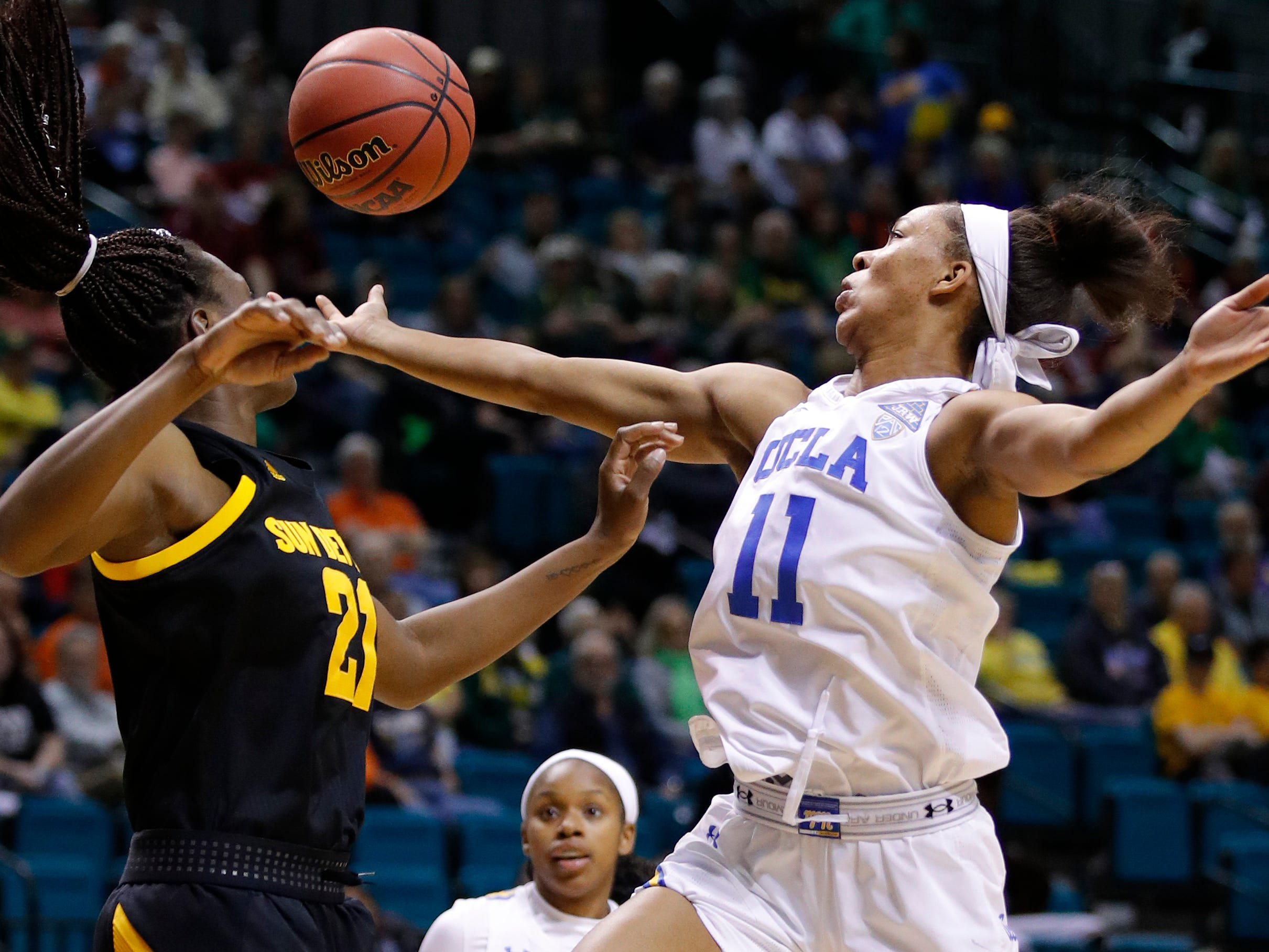 UCLA's Lajahna Drummer, right, grabs a rebound over Arizona State's Sophia Elenga during the first half of an NCAA college basketball game at the Pac-12 women's tournament Friday, March 8, 2019, in Las Vegas.