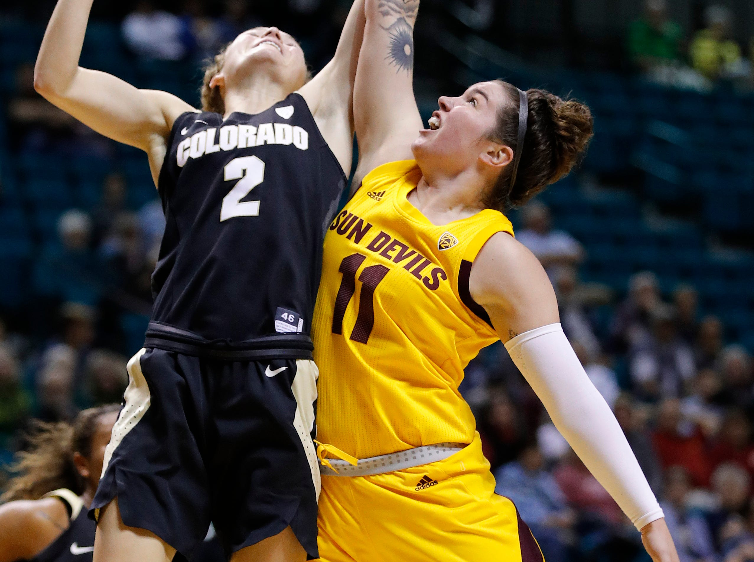 Colorado's Alexis Robinson, left, and Arizona State's Robbi Ryan battle for a rebound during the second half of an NCAA college basketball game at the Pac-12 women's tournament Thursday, March 7, 2019, in Las Vegas. (AP Photo/John Locher)
