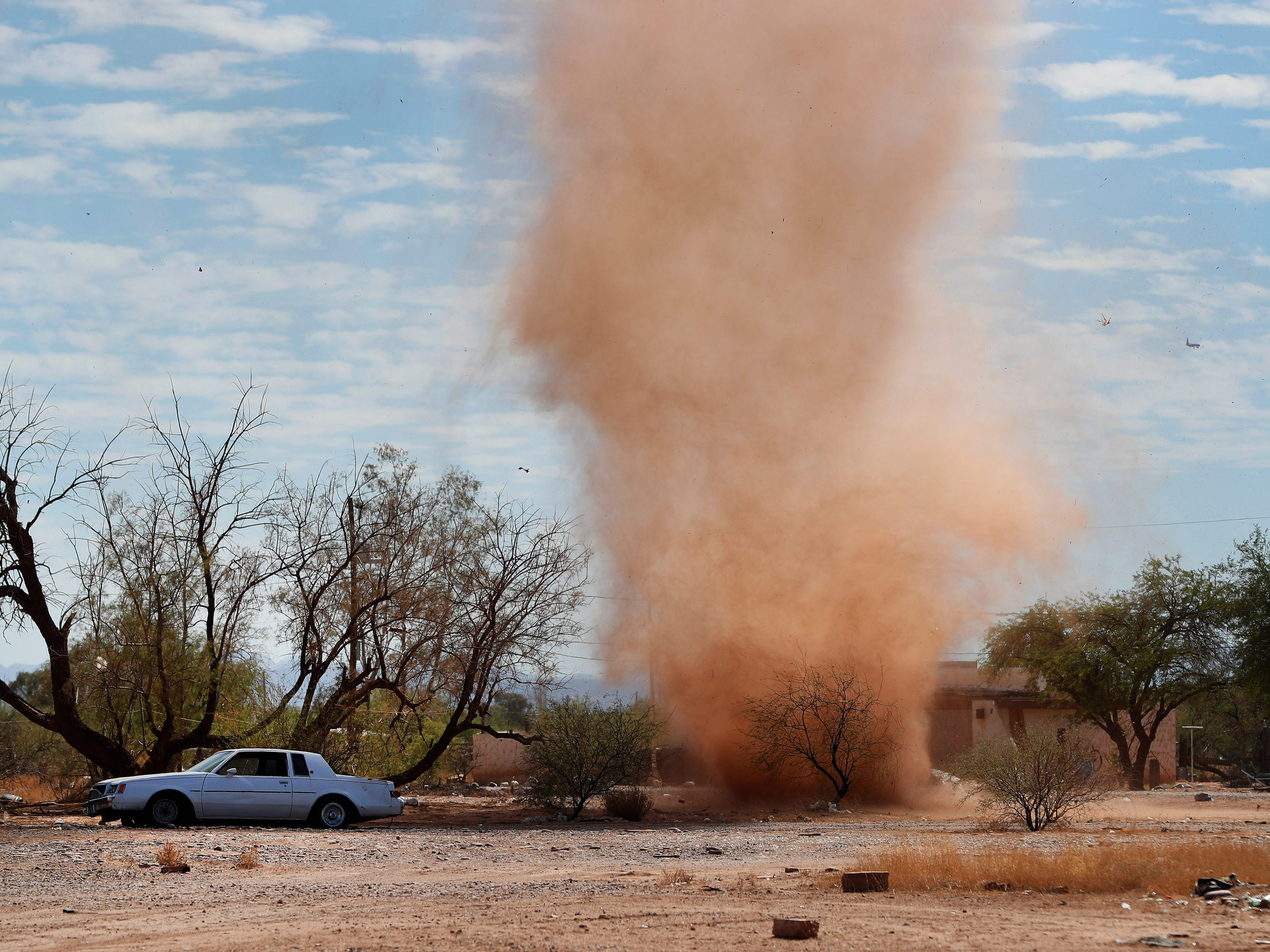 A dust devil rolls through the Salt River Pima-Maricopa Indian Reservation. Dust devils form when a pocket of hot air from the ground rises quickly through cooler air above it, forming an updraft.