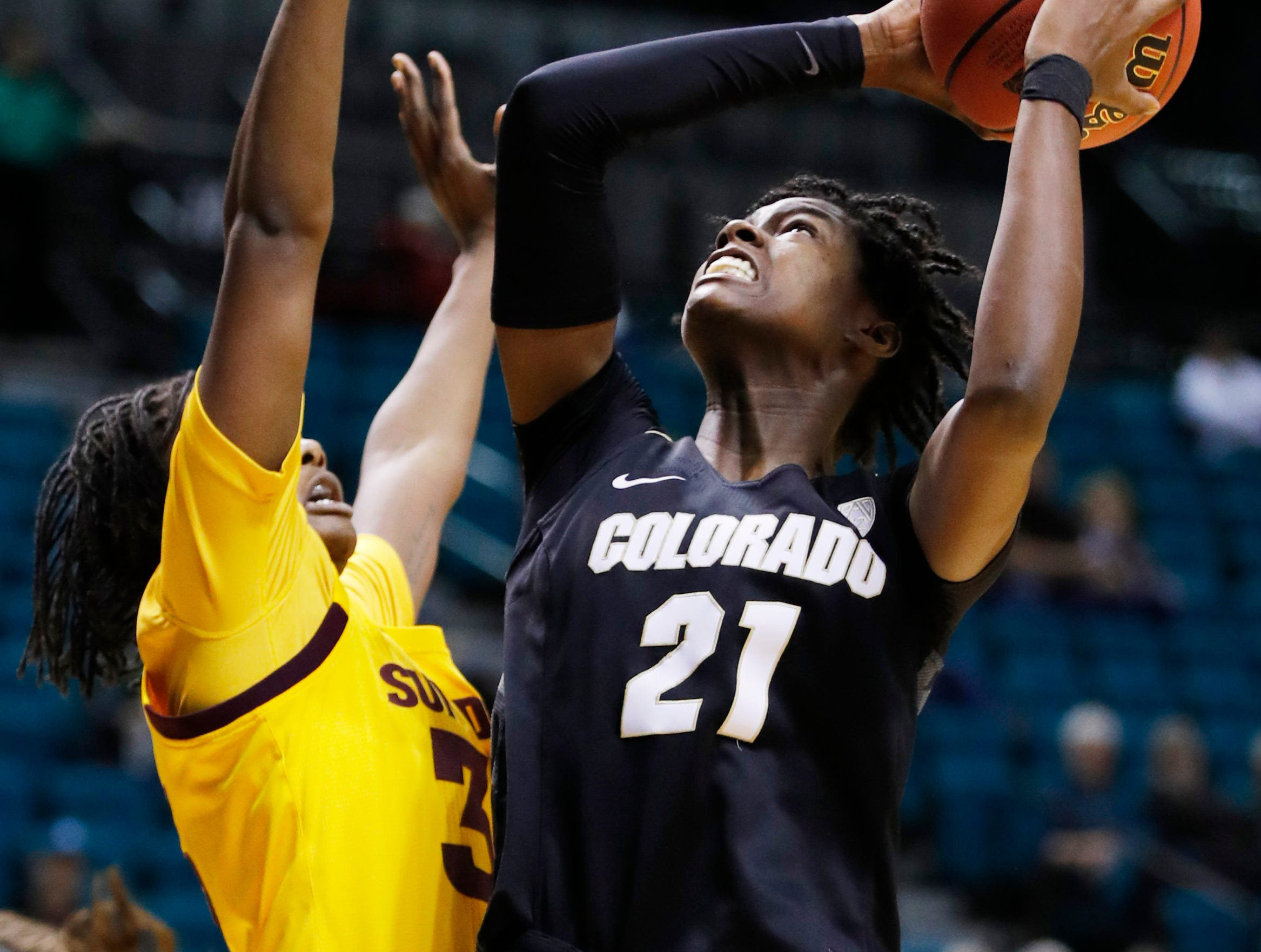 Colorado's Mya Hollingshed shoots over Arizona State's Charnea Johnson-Chapman during the first half of an NCAA college basketball game at the Pac-12 women's tournament Thursday, March 7, 2019, in Las Vegas. (AP Photo/John Locher)