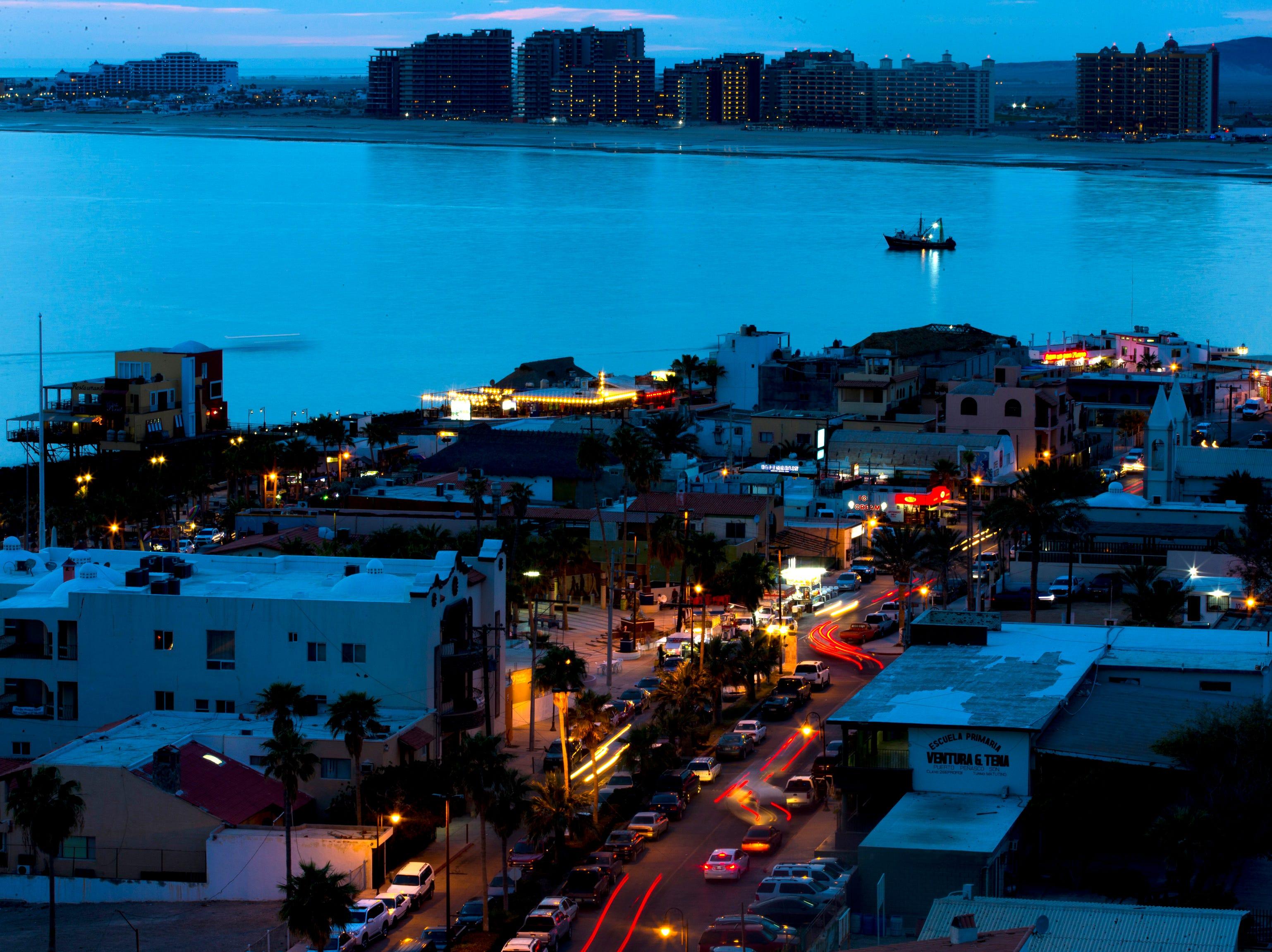 Night falls on the Malecon in Puerto Penasco, Mexico.