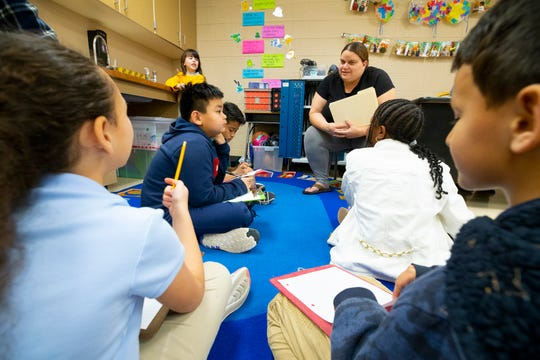 Third grade student teacher Christena Tamayo works with students in a group setting at Copper Trails School in Goodyear on March 6, 2019.