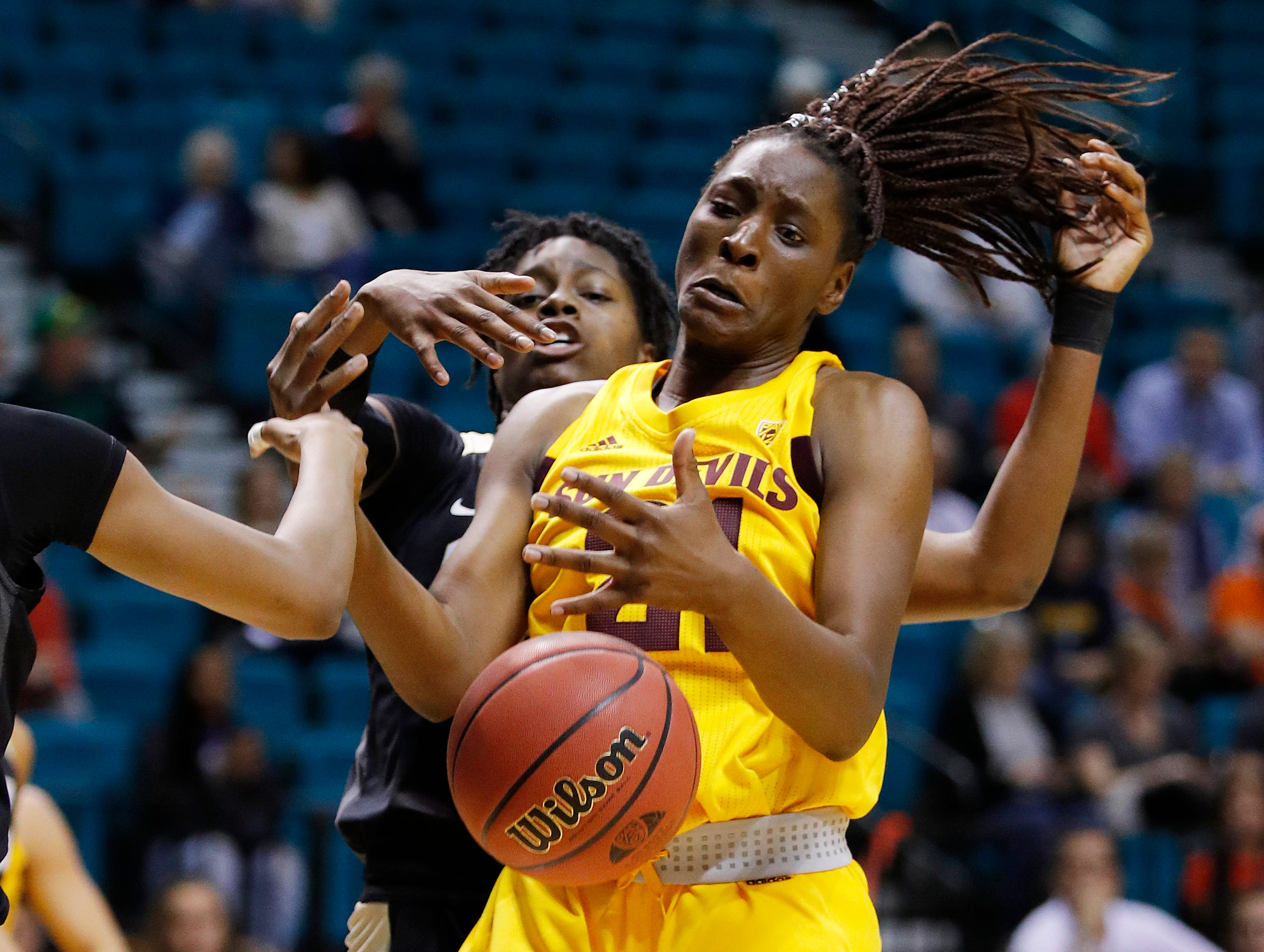Arizona State's Sophia Elenga, right, battles for a rebound with Colorado's Mya Hollingshed during the second half of an NCAA college basketball game at the Pac-12 women's tournament Thursday, March 7, 2019, in Las Vegas. (AP Photo/John Locher)