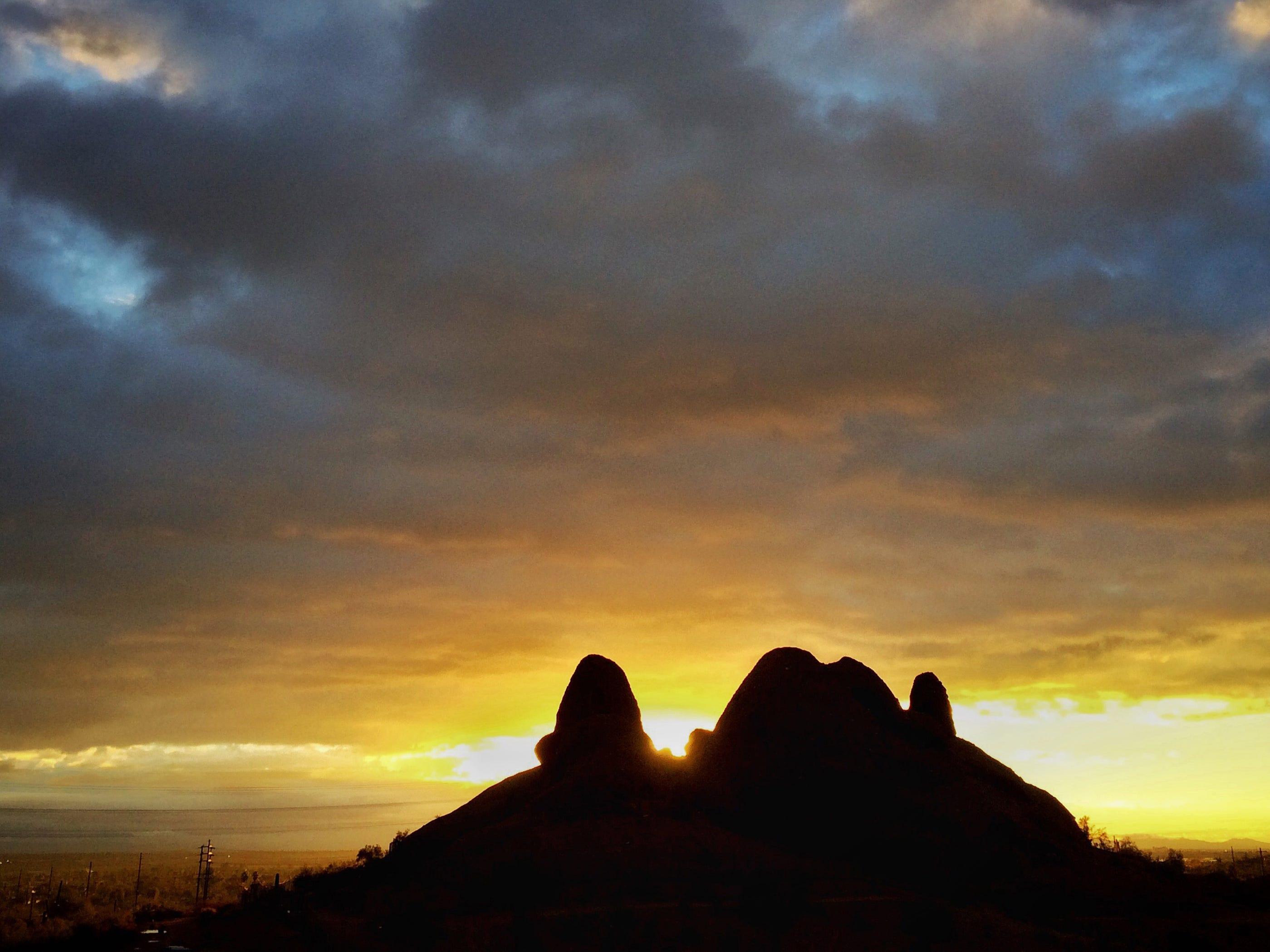 The sun rises at Papago Park after a rainy night.