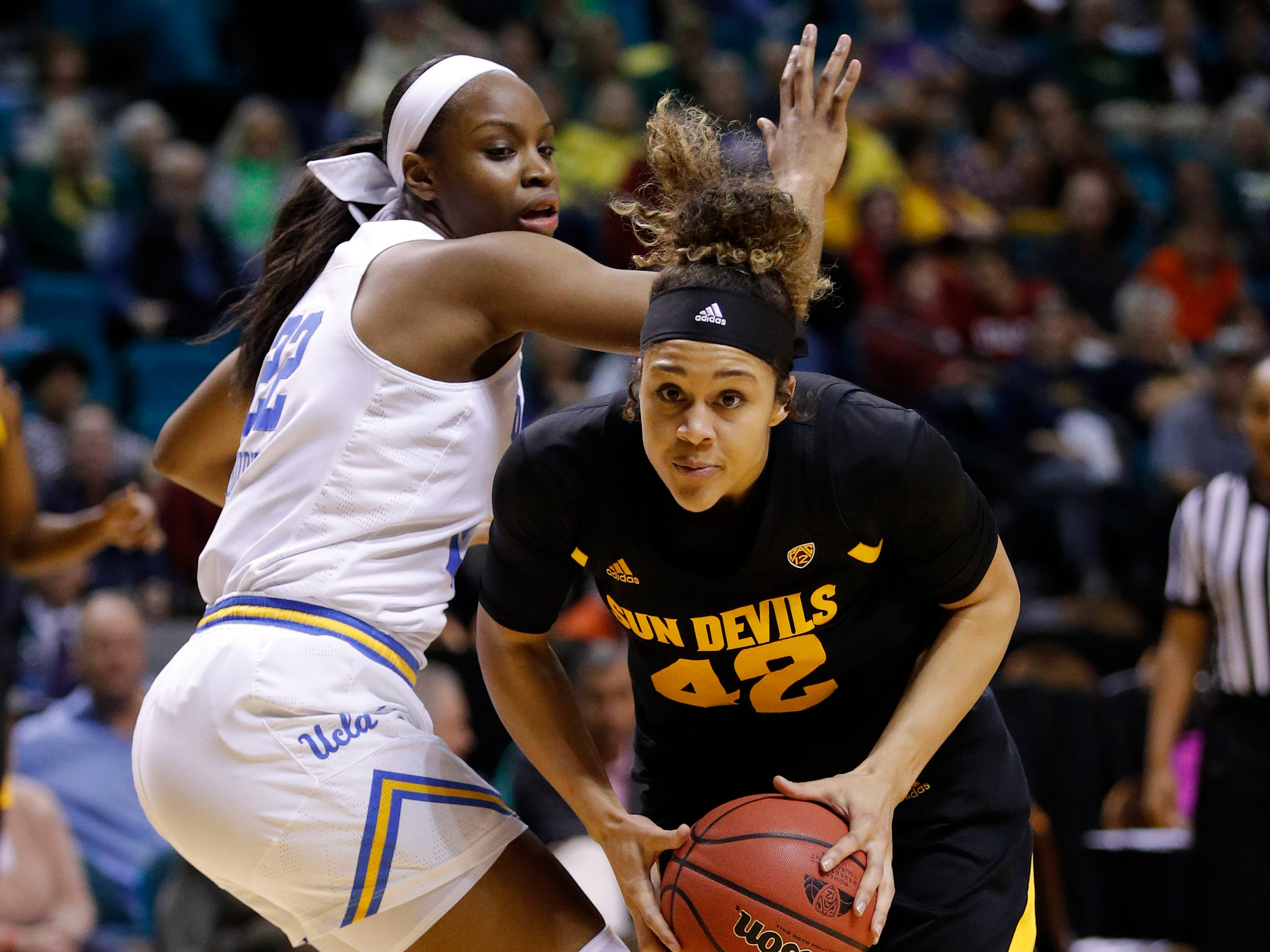 Arizona State's Kianna Ibis drives around UCLA's Kennedy Burke during the first half of an NCAA college basketball game at the Pac-12 women's tournament Friday, March 8, 2019, in Las Vegas.