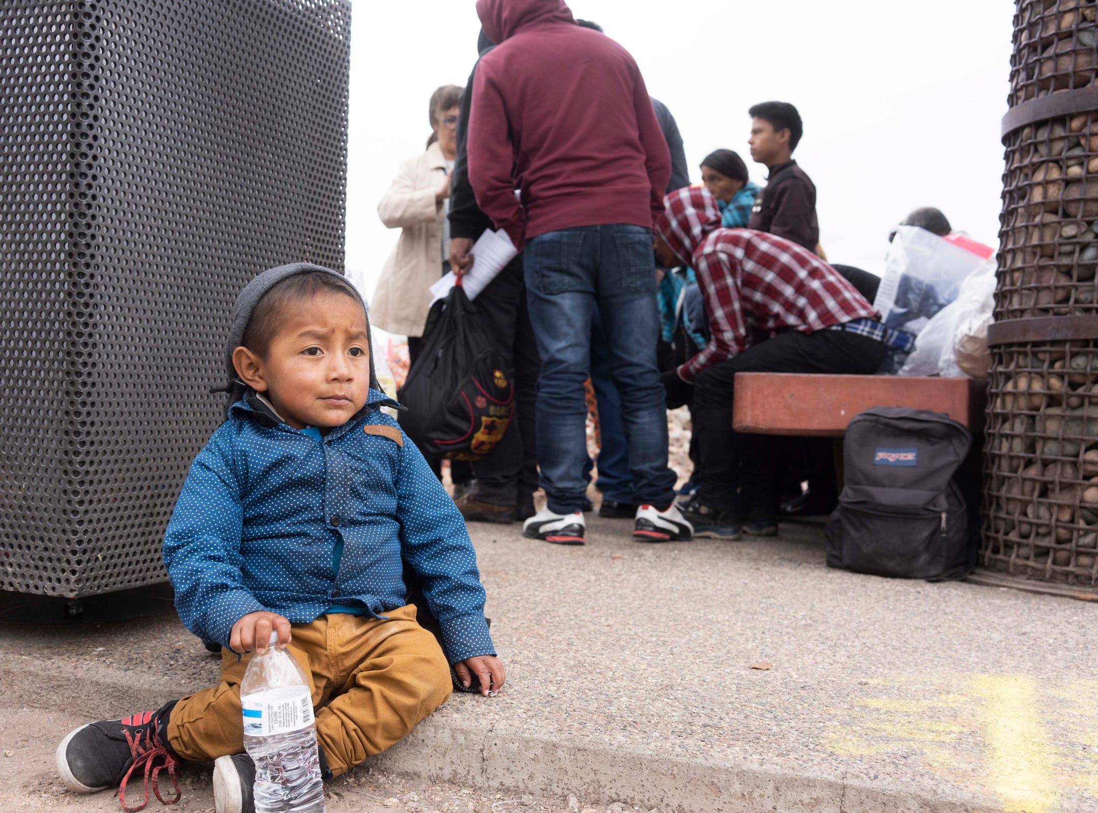 Dozens of Central American migrants are dropped off at a Phoenix Greyhound bus station by ICE federal officials while a group of volunteers tries to help them on March 8, 2019. Many churches and organizations are running out of resources to help the mingrants.