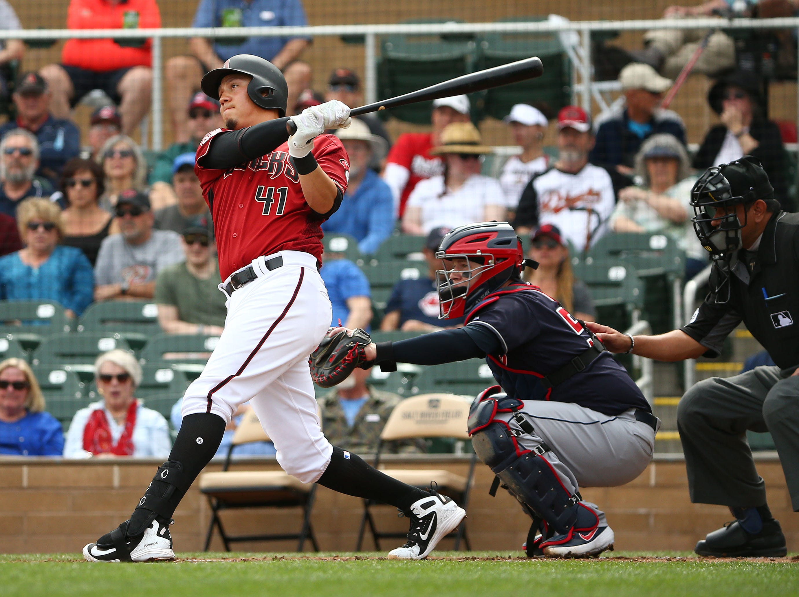 Arizona Diamondbacks Wilmer Flores (41) hits a two-run home run against the Cleveland Indians in the 1st inning during a spring training game on Mar. 7, 2019 at Salt River Fields in Scottsdale, Ariz.