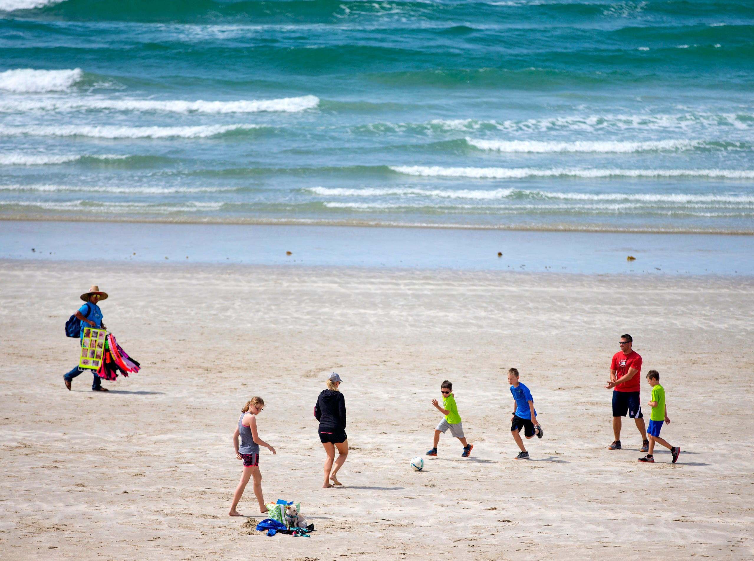 Wide and long beaches and a low tide make for a great soccer game on Sandy Beach in Puerto Penasco, Mexico.