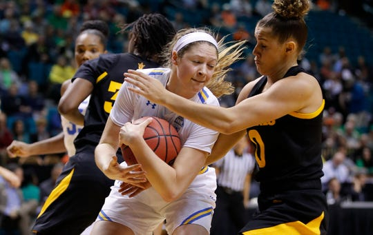 UCLA's Lindsey Corsaro and Arizona State's Taya Hanson, right, battle for a rebound during the first half of a Pac-12 Tournament game on March 8 in Las Vegas.