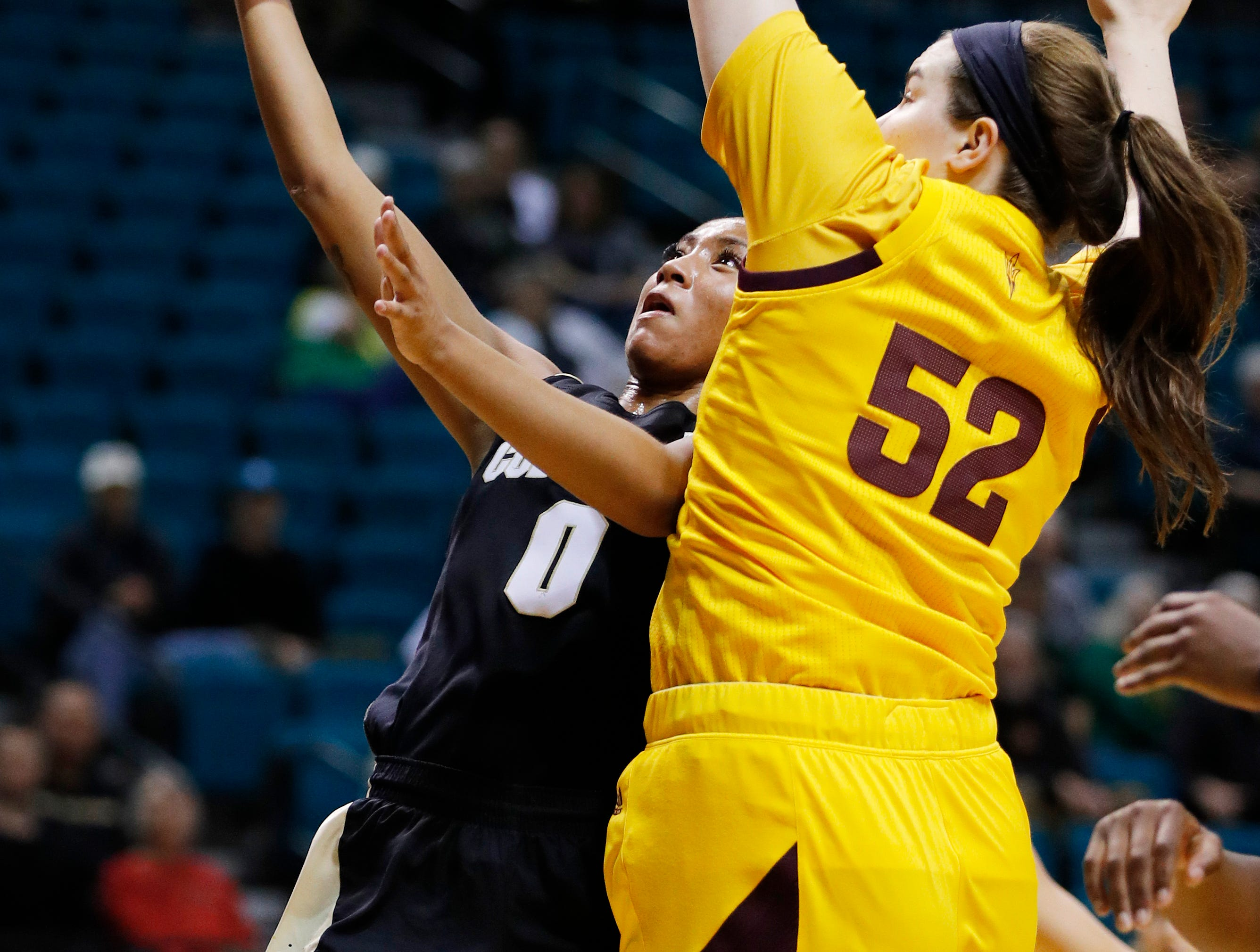 Colorado's Quinessa Caylao-Do (0) shoots around Arizona State's Jamie Ruden (52) during the first half of an NCAA college basketball game at the Pac-12 women's tournament Thursday, March 7, 2019, in Las Vegas. (AP Photo/John Locher)