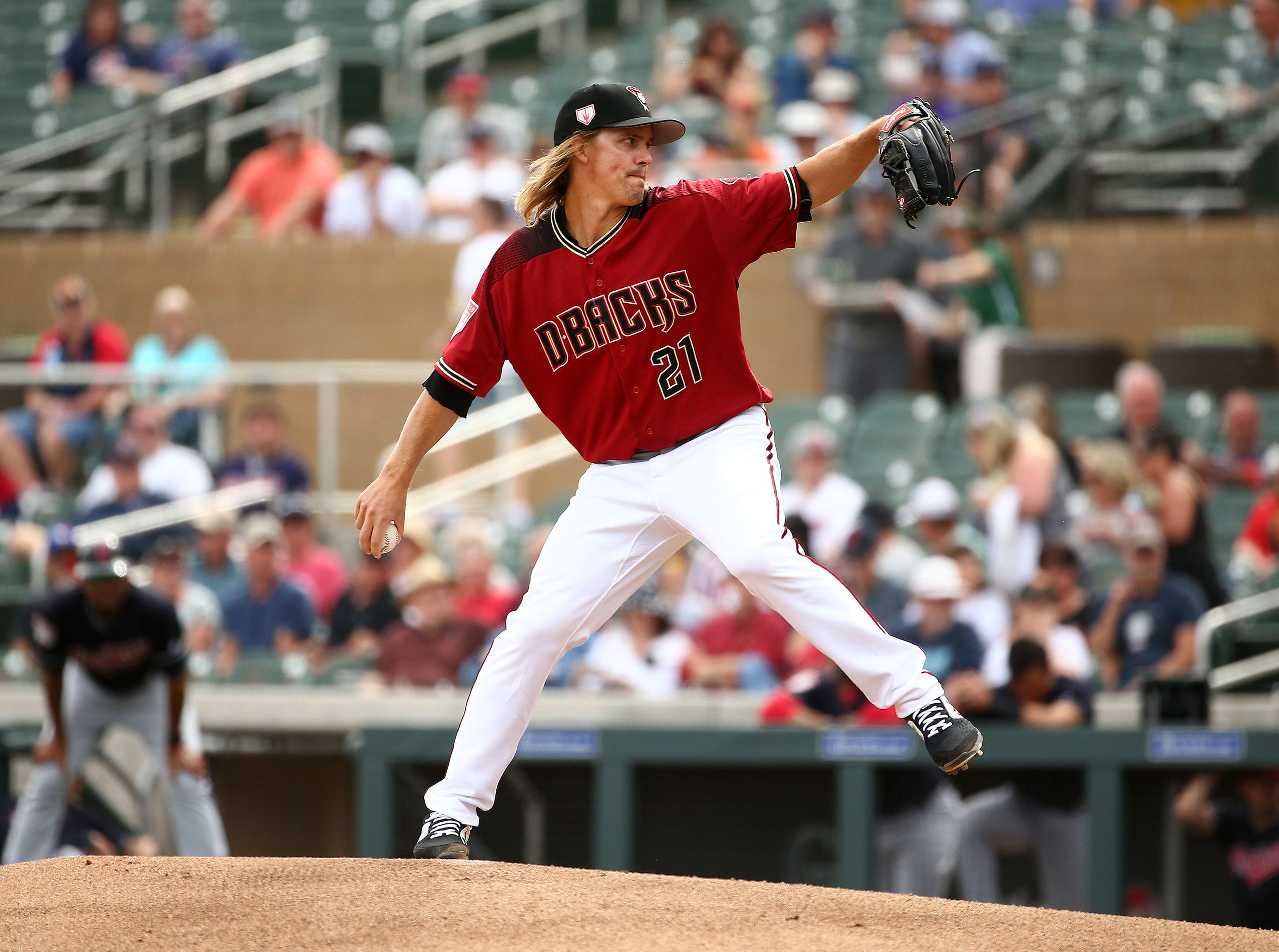 Arizona Diamondbacks pitcher Zack Greinke throws to the Cleveland Indians in the first inning during a spring training game on Mar. 7, 2019 at Salt River Fields in Scottsdale, Ariz.