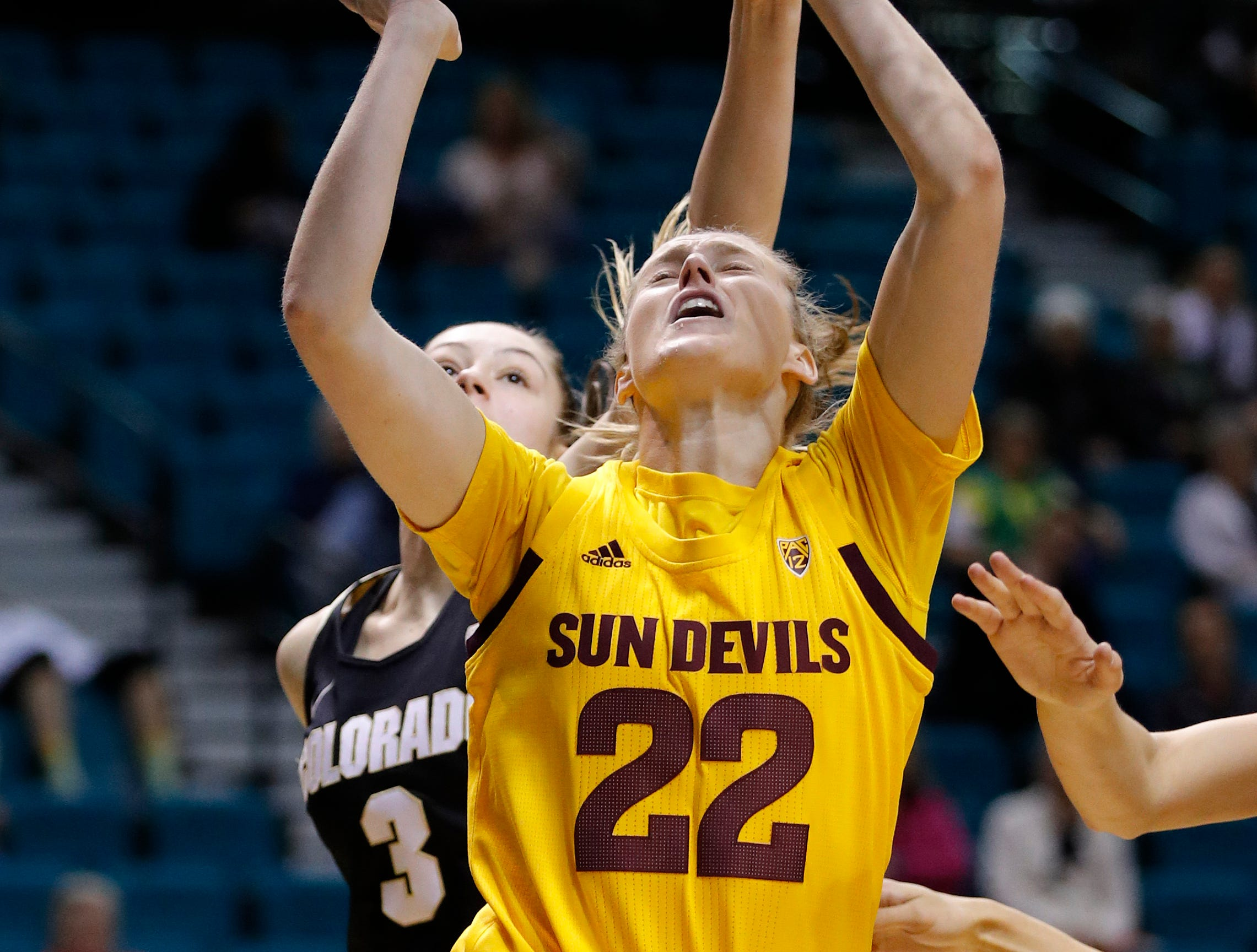 Colorado's Emma Clarke (3) knocks the ball away from Arizona State's Courtney Ekmark during the second half of an NCAA college basketball game at the Pac-12 women's tournament Thursday, March 7, 2019, in Las Vegas. (AP Photo/John Locher)