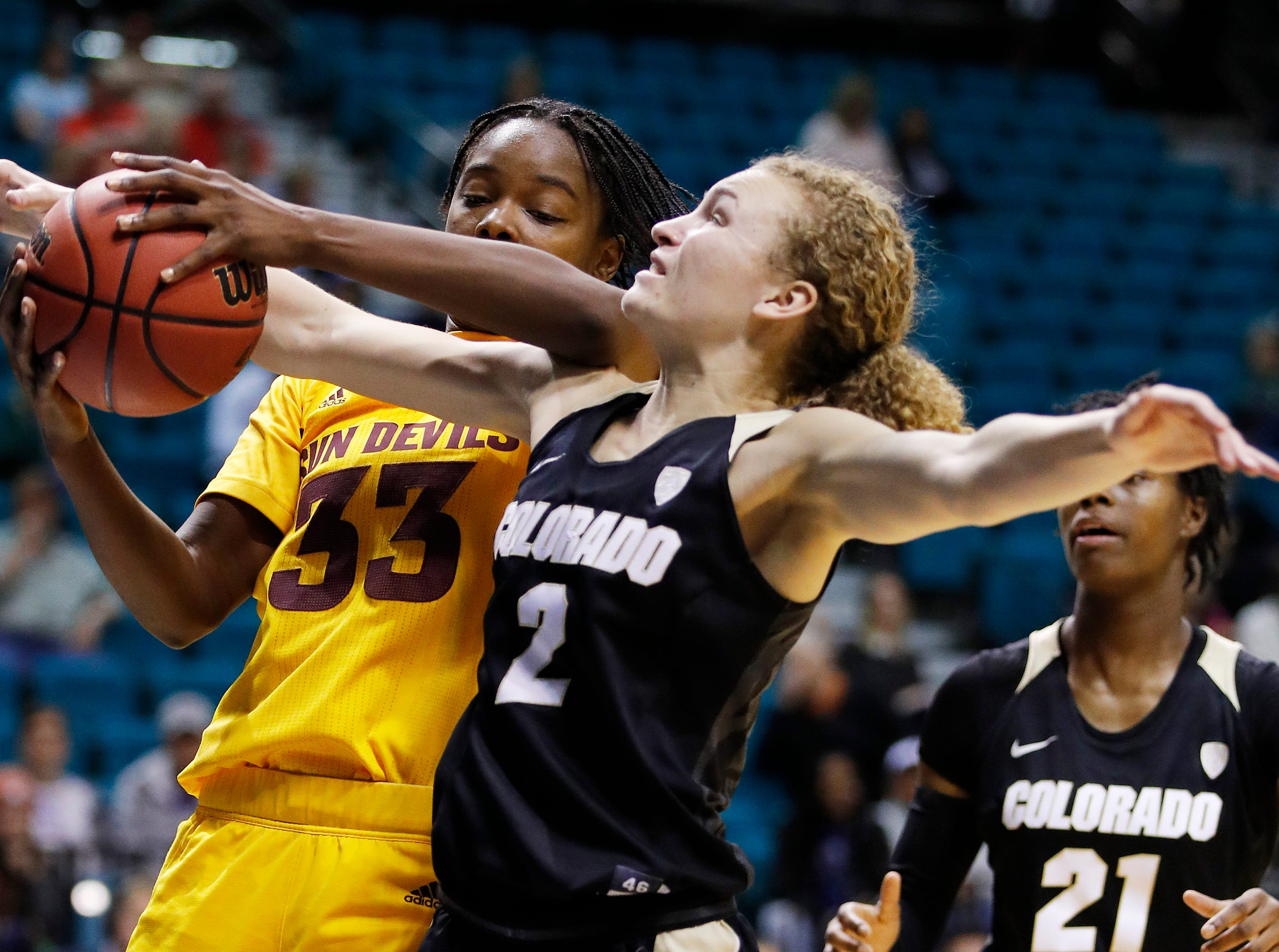 Arizona State's Charnea Johnson-Chapman (33) and Colorado's Alexis Robinson (2) vie for a rebound during the second half of an NCAA college basketball game at the Pac-12 women's tournament Thursday, March 7, 2019, in Las Vegas. (AP Photo/John Locher)