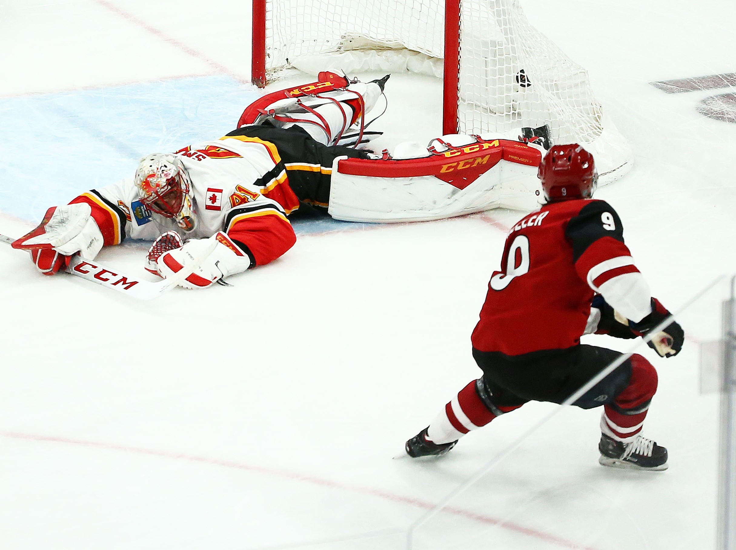 Arizona Coyotes center Clayton Keller (9) scores a goal past Calgary Flames goaltender Mike Smith (41) in the first period on Mar. 7, 2019, at Gila River Arena in Glendale, Ariz.
