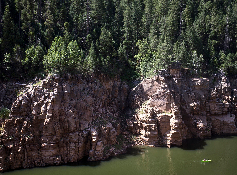 Helen Boemmels, of Phoenix, kayaks on the C.C. Cragin (Blue Ridge) Reservoir on August 20, 2018,