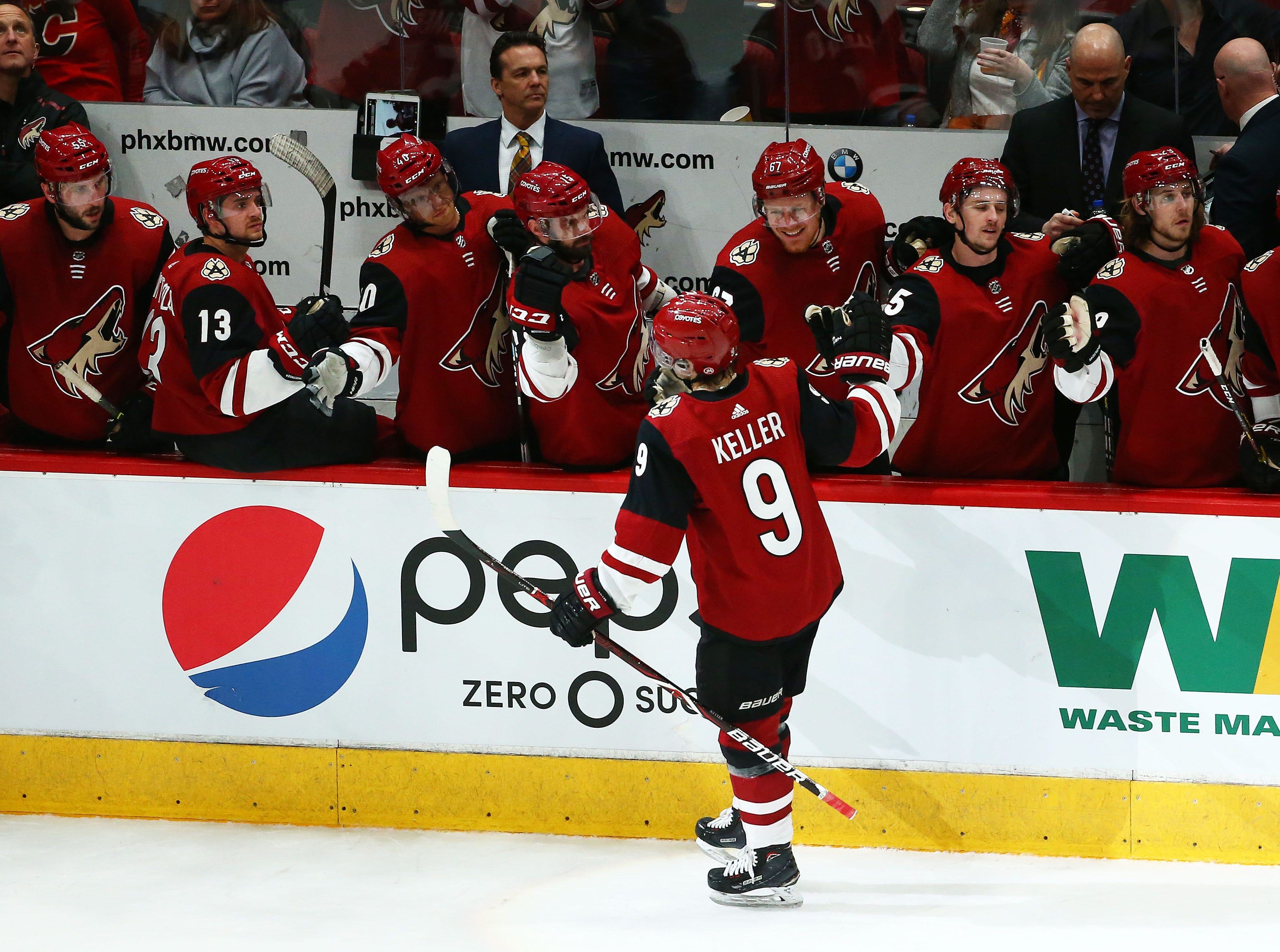 Arizona Coyotes center Clayton Keller (9) celebrates his goal against the Calgary Flames in the first period on Mar. 7, 2019, at Gila River Arena in Glendale, Ariz.