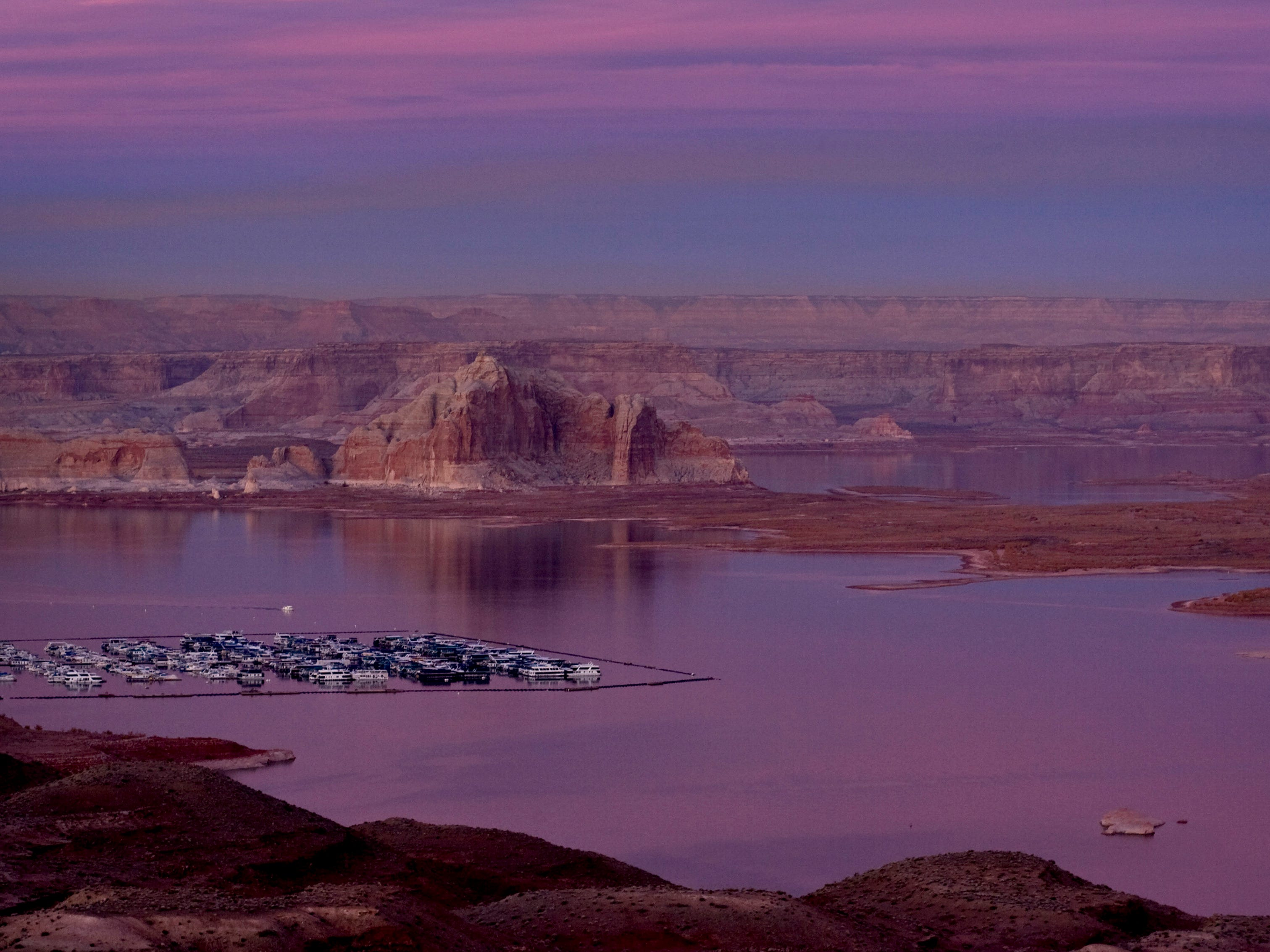 All seems still as the sun sets on Lake Powell's Wahweap Marina. Lake Powell sits at 48 percent of capacity, 101 feet below its full elevation of 3,700 feet above sea level.