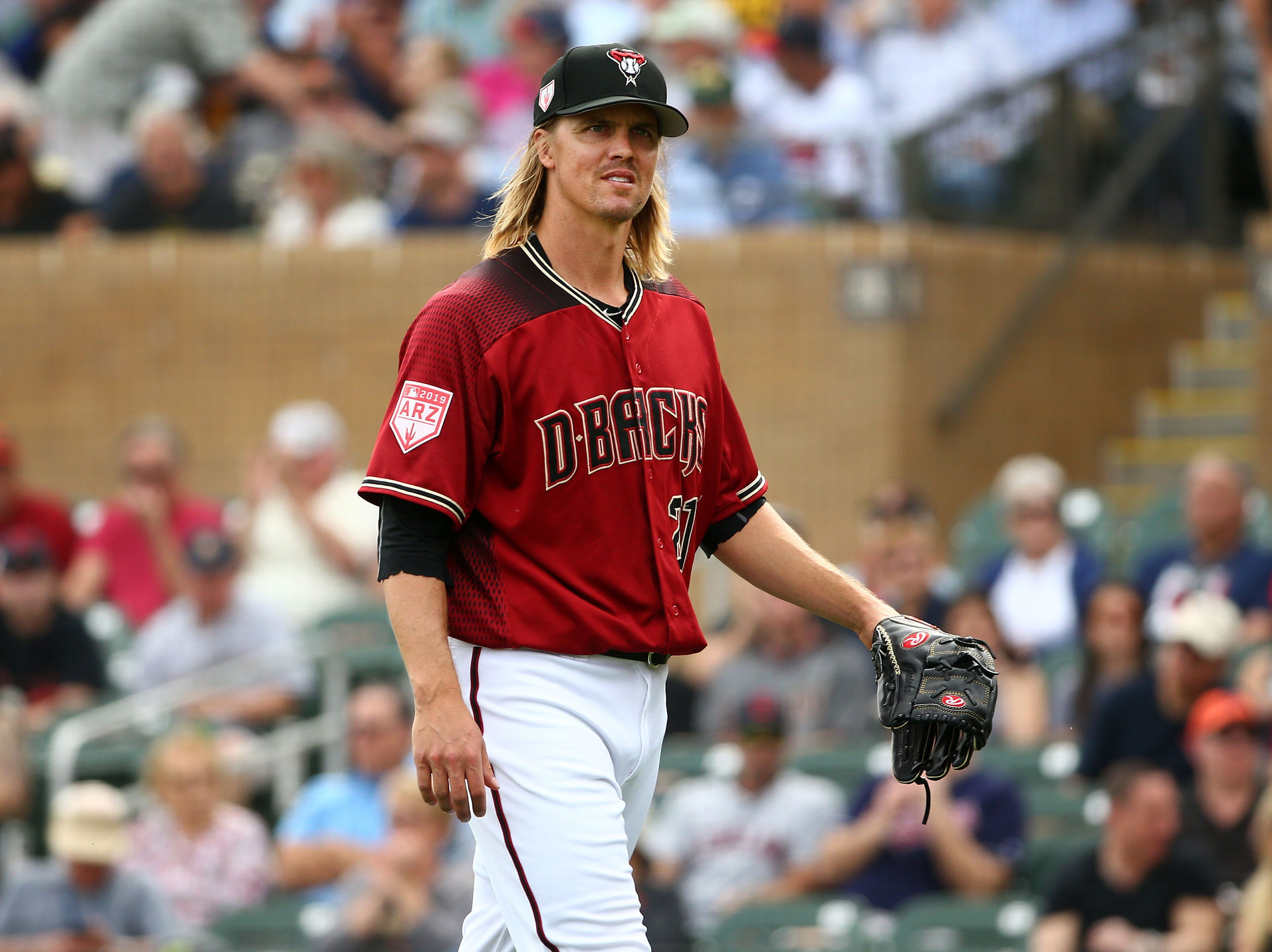 Arizona Diamondbacks pitcher Zack Greinke retires the Cleveland Indians in the first inning during a spring training game on Mar. 7, 2019 at Salt River Fields in Scottsdale, Ariz.