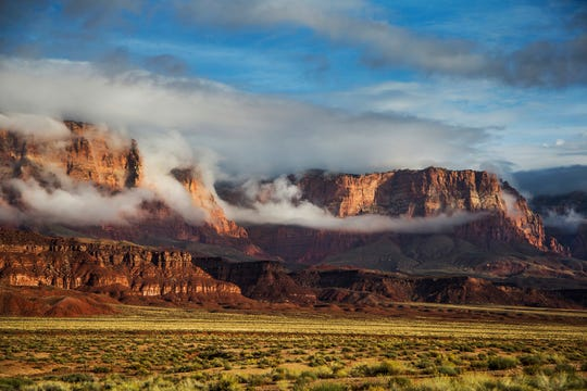 The Vermilion Cliffs in northern Arizona are shrouded in early morning fog on October 18, 2015.