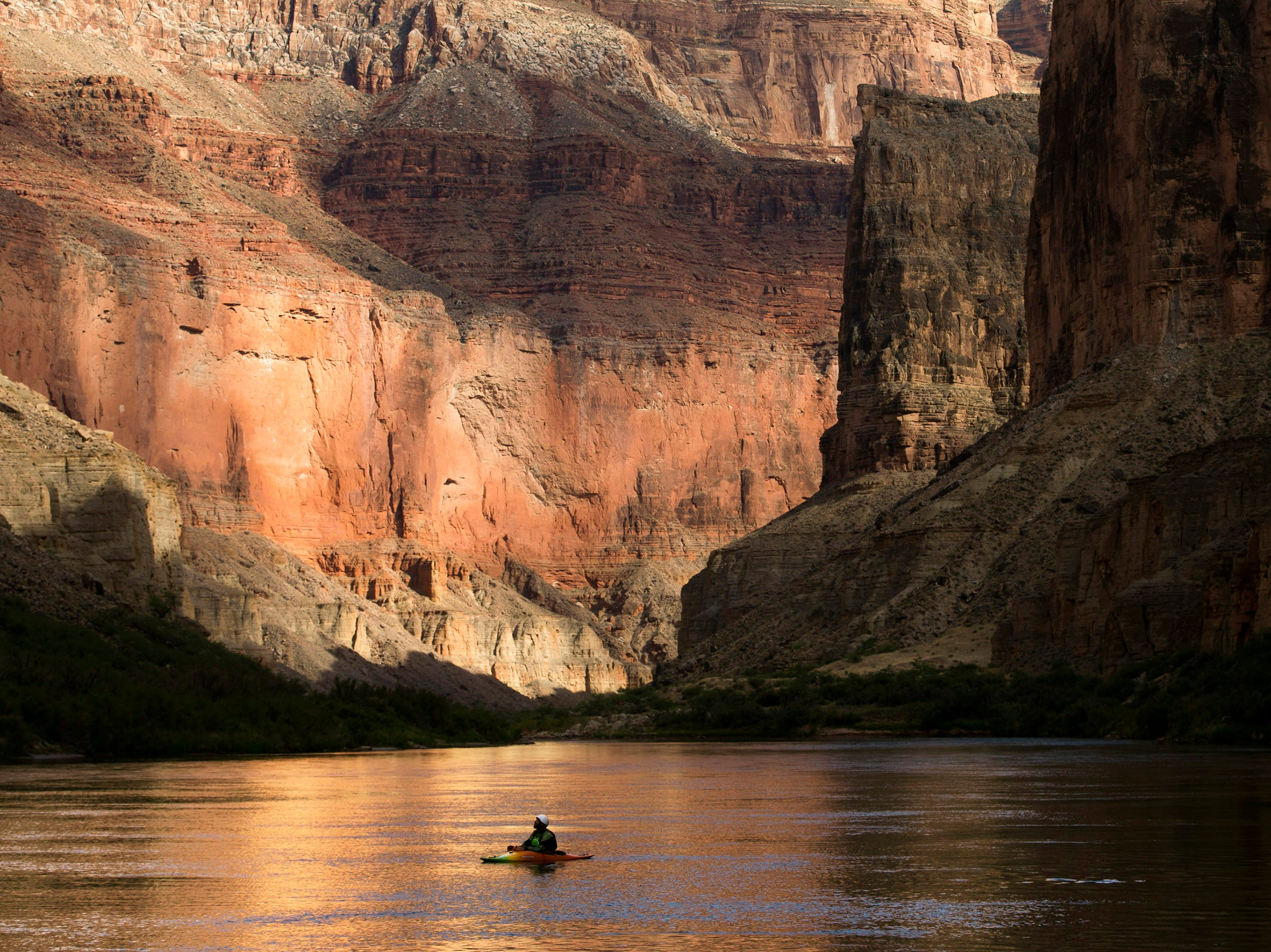 Ezra Jones takes in the canyon walls from his kayak on the Colorado River in Grand Canyon National Park on May 19, 2018.