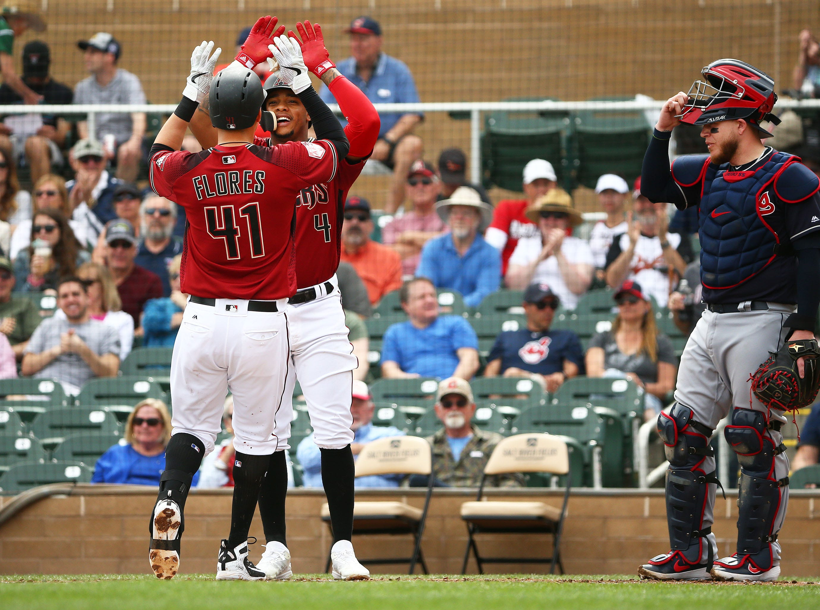 Arizona Diamondbacks Wilmer Flores (41) high-fives Ketel Marte after hitting a two-run home run against the Cleveland Indians in the 1st inning during a spring training game on Mar. 7, 2019 at Salt River Fields in Scottsdale, Ariz.