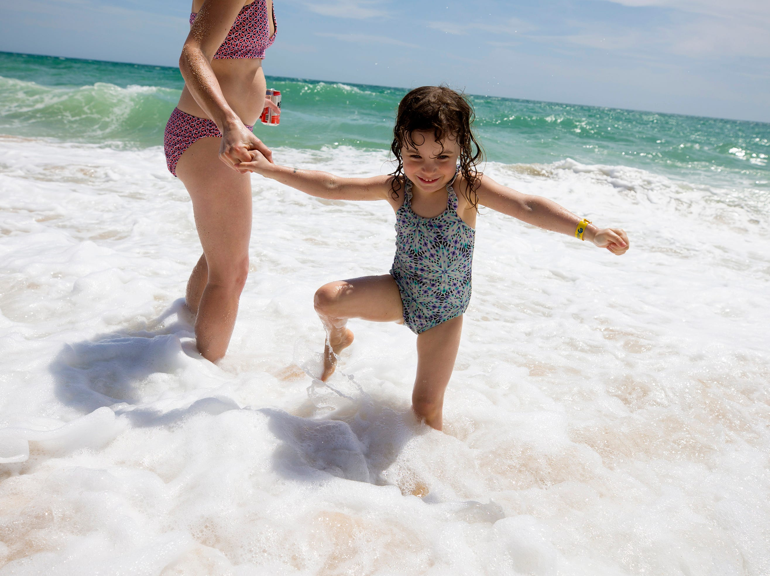 Caroline Belcher, from Vermont, plays with her daughter Olivia Keegan, 3, on Sandy Beach in Puerto Penasco, Mexico.