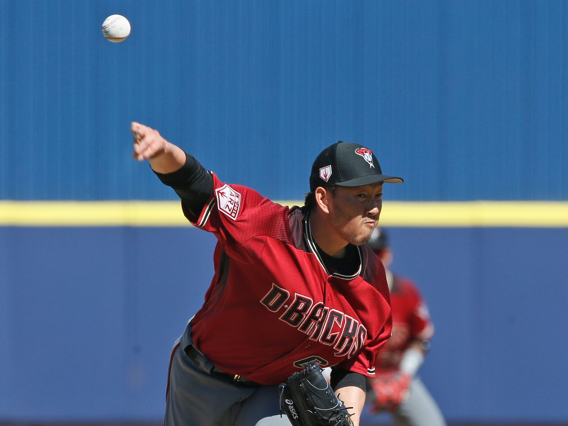 Arizona Diamondbacks pitcher Yoshihisa Hirano throws in the sixth inning of a spring training baseball game against the Milwaukee Brewers, Friday, March 8, 2019, in Phoenix.