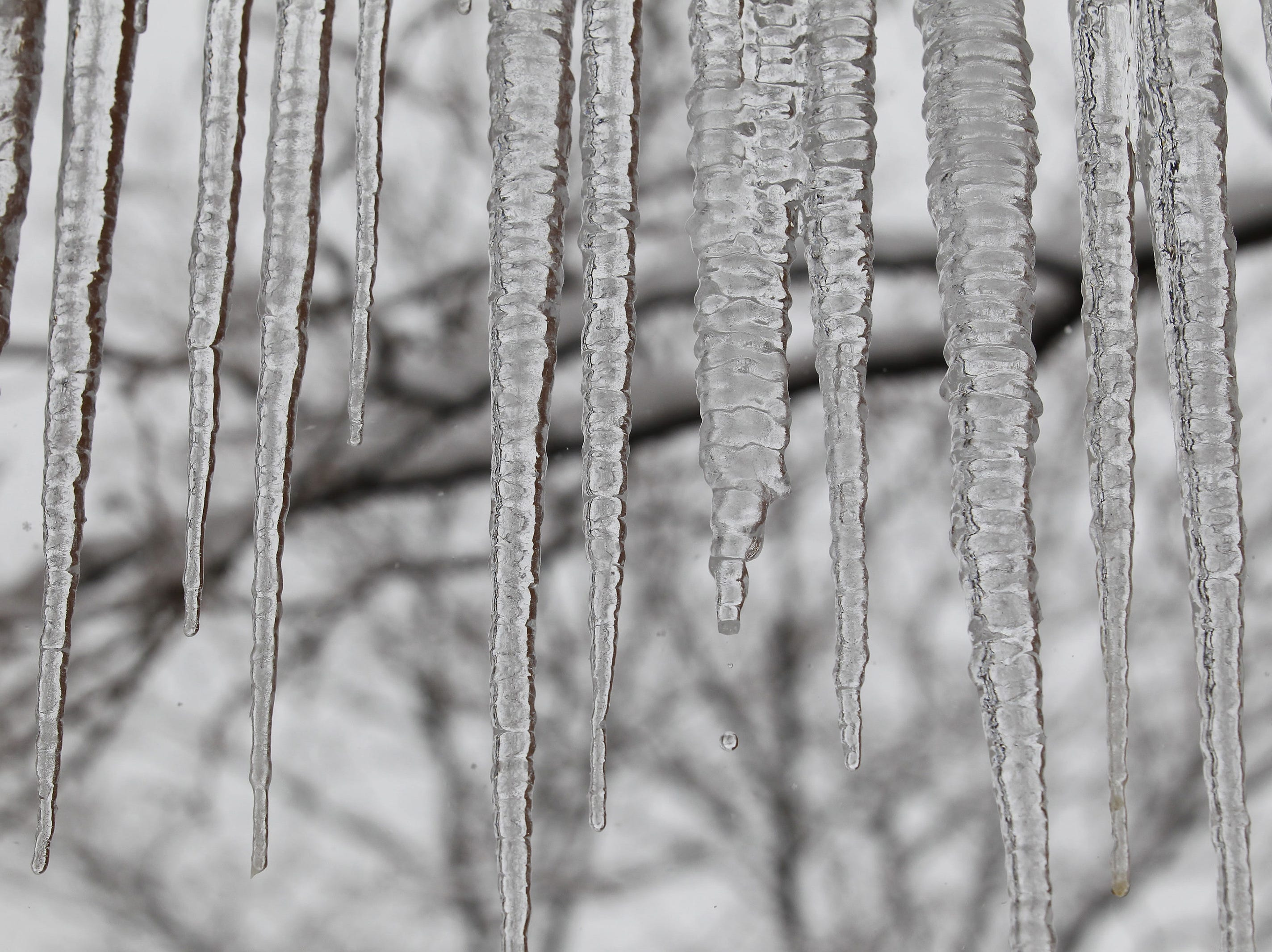 Icicles form along the roof line at Allen Hall on the campus of Northern Arizona University, as a winter storm brings heavy snow to Flagstaff, AZ.