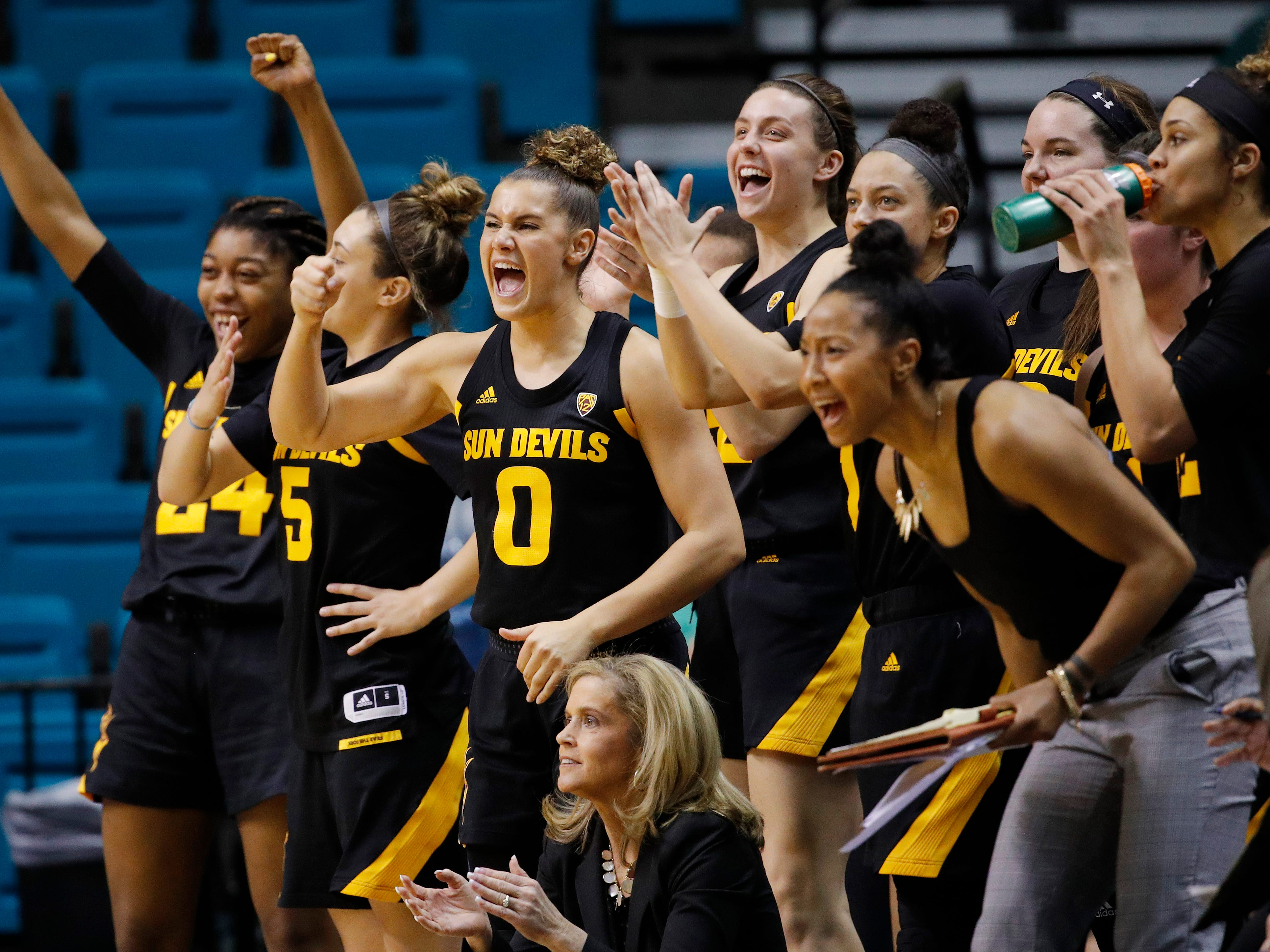 Arizona State's Taya Hanson (0) and others cheer during the second half of an NCAA college basketball game against UCLA at the Pac-12 women's tournament Friday, March 8, 2019, in Las Vegas.