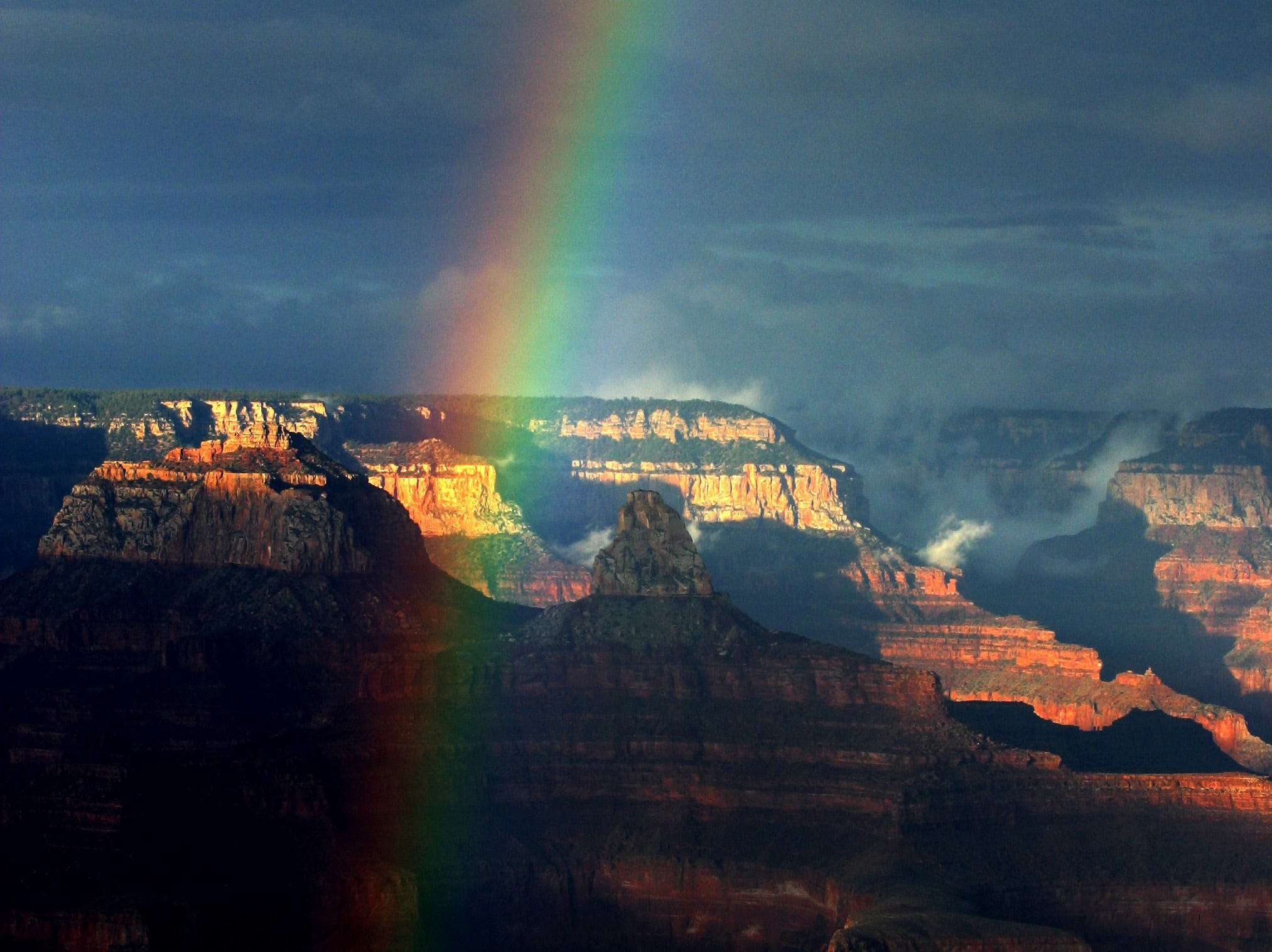 A rainbow arches through the Grand Canyon National Park in northern Arizona, Sept. 7, 2002.