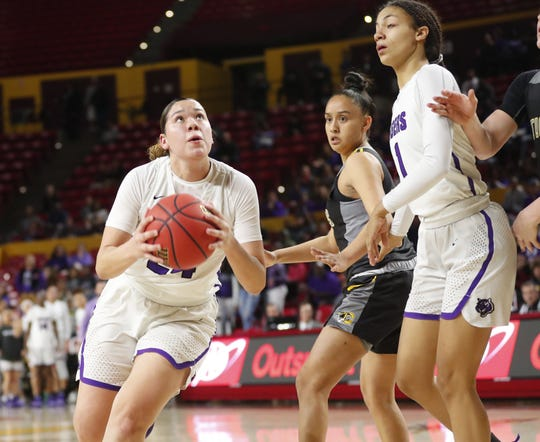 Millennium's Dominique Phillips (24) drives towards the basket against against Gilbert during the Girls State 5A Championship game in Tempe, Ariz. Feb. 25, 2019.