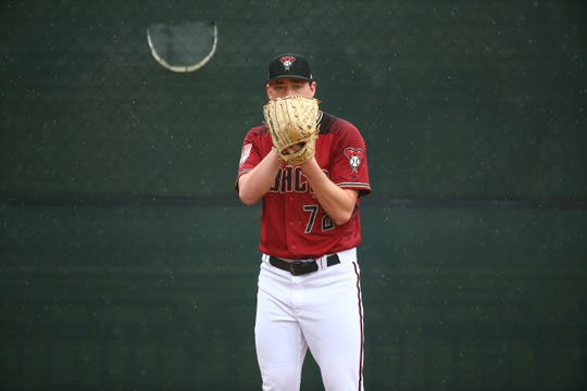 Diamondbacks pitcher Taylor Clarke gets set to throw during a spring training workout on Feb. 14 at Salt River Fields.