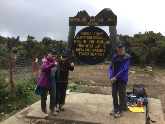 Betty Schley (left) with Catherine Buick and Shaun Bennett (right) during their trip to the summit of Mt. Kilimanjaro in February 2019.