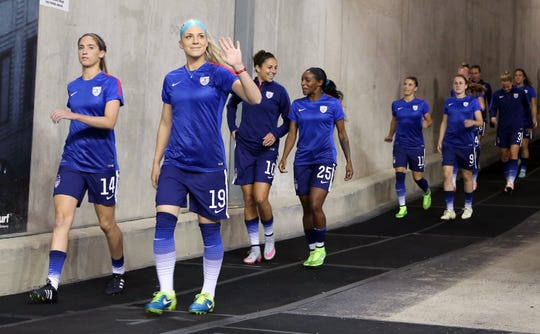 Members of the U.S. women's national team take the field prior to the Women's World Cup victory tour game against Haiti at Ford Field.
