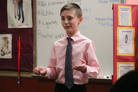 "Kain Hoyt, a seventh grader at PCMS, describes his shoe business idea during the Young Entrepreneurs' ""Shark Tank"" event on Wednesday."