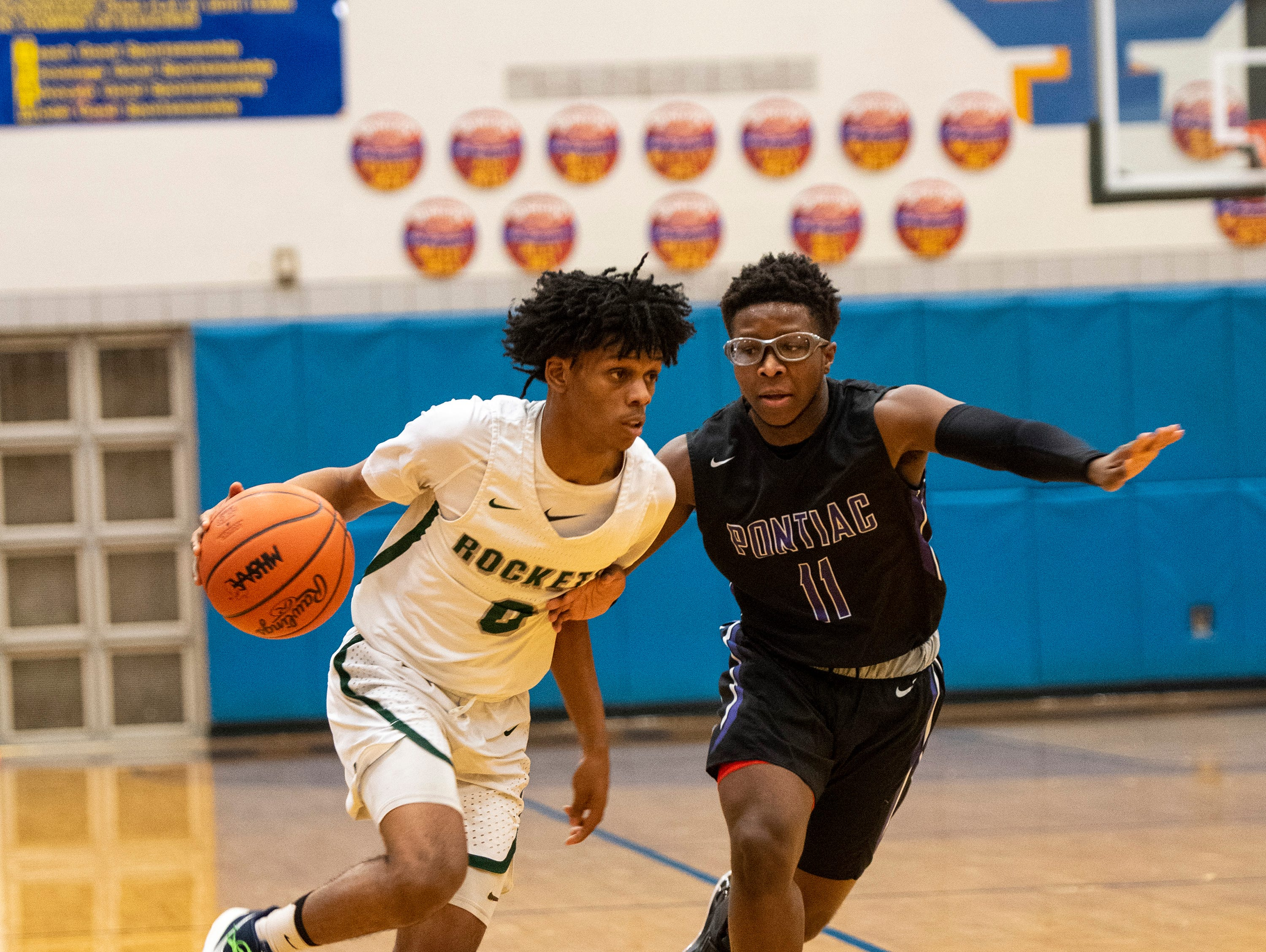 Pontiac HIgh School's Keyshaun Shelmonson-Bey (11) defends against New Haven's Ronald Jeffery III in the MHSAA Division 2 regional basketball finals Thursday, March 7, 2019 at Imlay City High School.