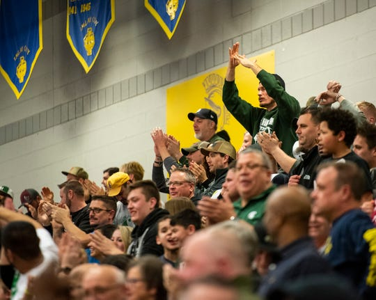 Fans cheer after a 3-pointer made at the buzzer by New Haven's Ronald Jeffery III in the MHSAA Division 2 regional basketball finals against Pontiac High School Thursday, March 7, 2019 at Imlay City High School.