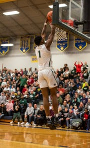 New Haven's Romeo Weems goes for a dunk in the MHSAA Division 2 regional basketball finals against Pontiac High School Thursday, March 7, 2019 at Imlay City High School.
