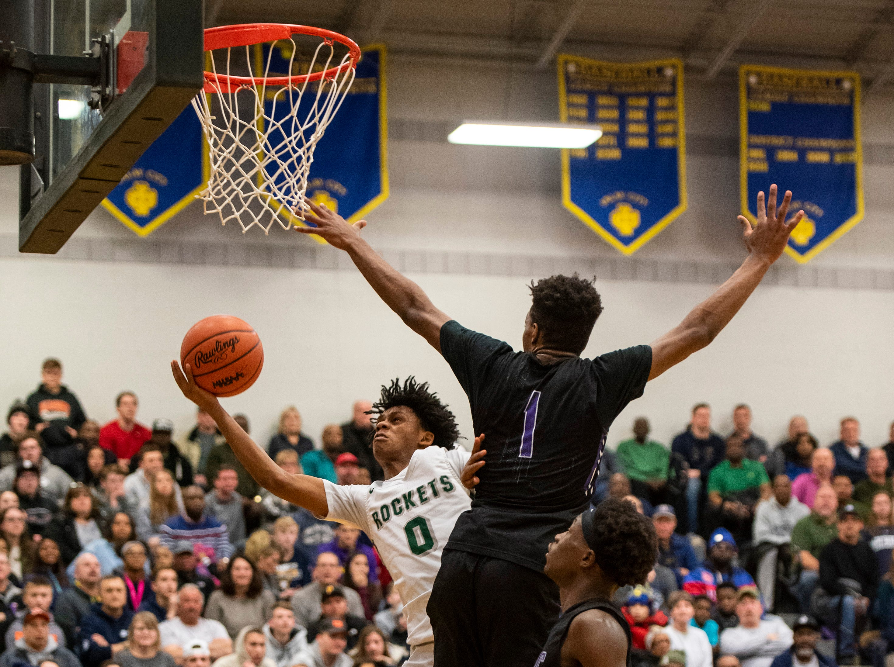 Pontiac's Aiden Rubio (1) jumps to attempt to block New Haven's Ronald Jeffery III in the MHSAA Division 2 regional basketball finals Thursday, March 7, 2019 at Imlay City High School.