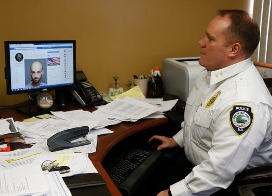 East Fishkill Police chief Matthew Orsino scrolls through the department's Facebook page where they occasionally post mug shots of people they arrest for higher level offenses on March 7, 2019.