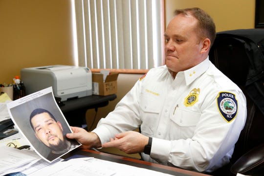 East Fishkill Police chief Matthew Orsino holds a mug shot of Michael Babb, who was charged with Criminal Possession of a Controlled Substance in the third degree at the East Fishkill Police Department on March 7, 2019.