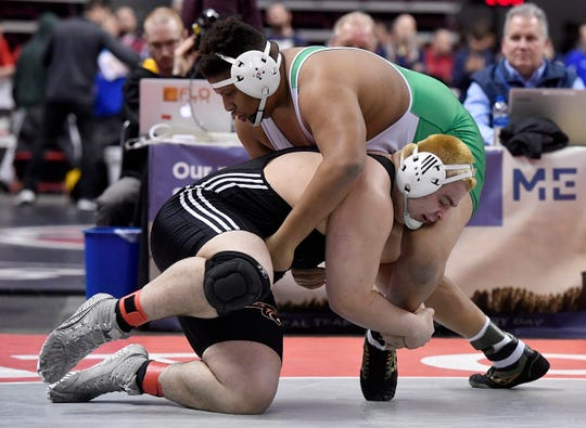 Michael Wolfgram of Central York gets the takedown on Quientin Franklin of South Fayette during the PIAA Class 3-A 285 pound first round match, Thursday, March 7, 2019.John A. Pavoncello photo