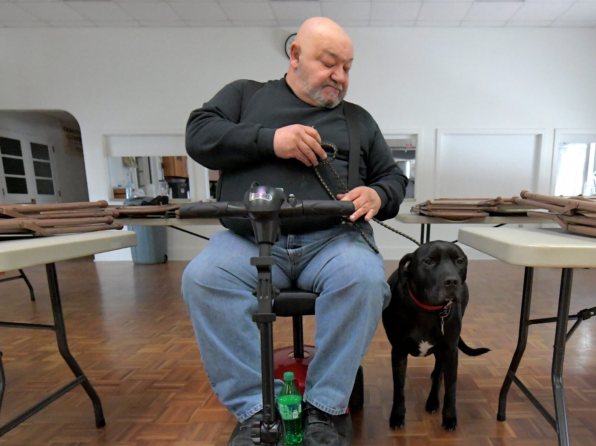 Bob Fink demonstrates the skills of his pit bull golden retriever mix Johnny Cash during a training session at Trinity Lutheran Church in East Berlin on Thursday, March 7, 2019. He was leading a session offered by Cover Six Canines, a ministry of Freedom Biker Church York, which gives free service dog training to veterans. Bill Kalina photo