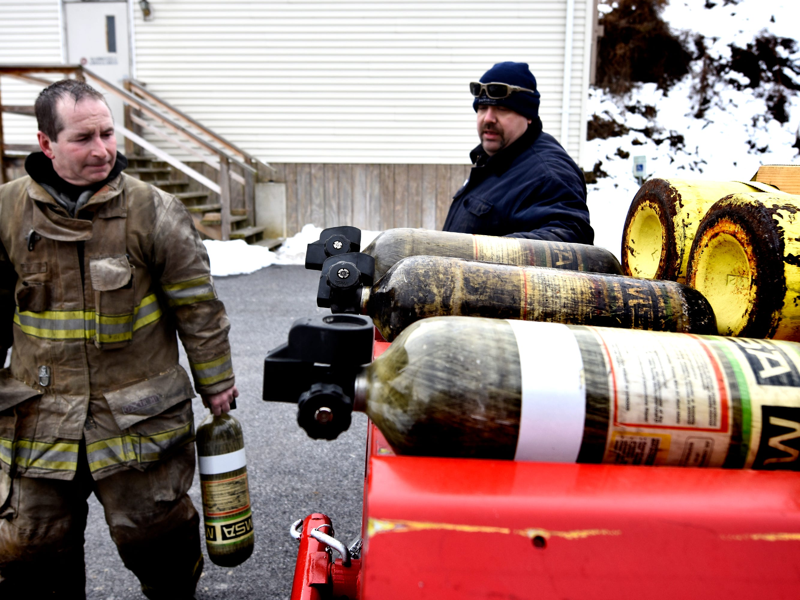 York County Fire School adjunct instructor Tom Rigling, left, and school administrator John Livingston organize air tanks while training York County Prison workers at the school Friday, March 8, 2019. Members of the prison's 30-member Fire Emergency Response Team were completing a 40-hour fire training course there. The FERT team is designed to control fire emergencies onsite prior to the arrival of firefighters. Bill Kalina photo