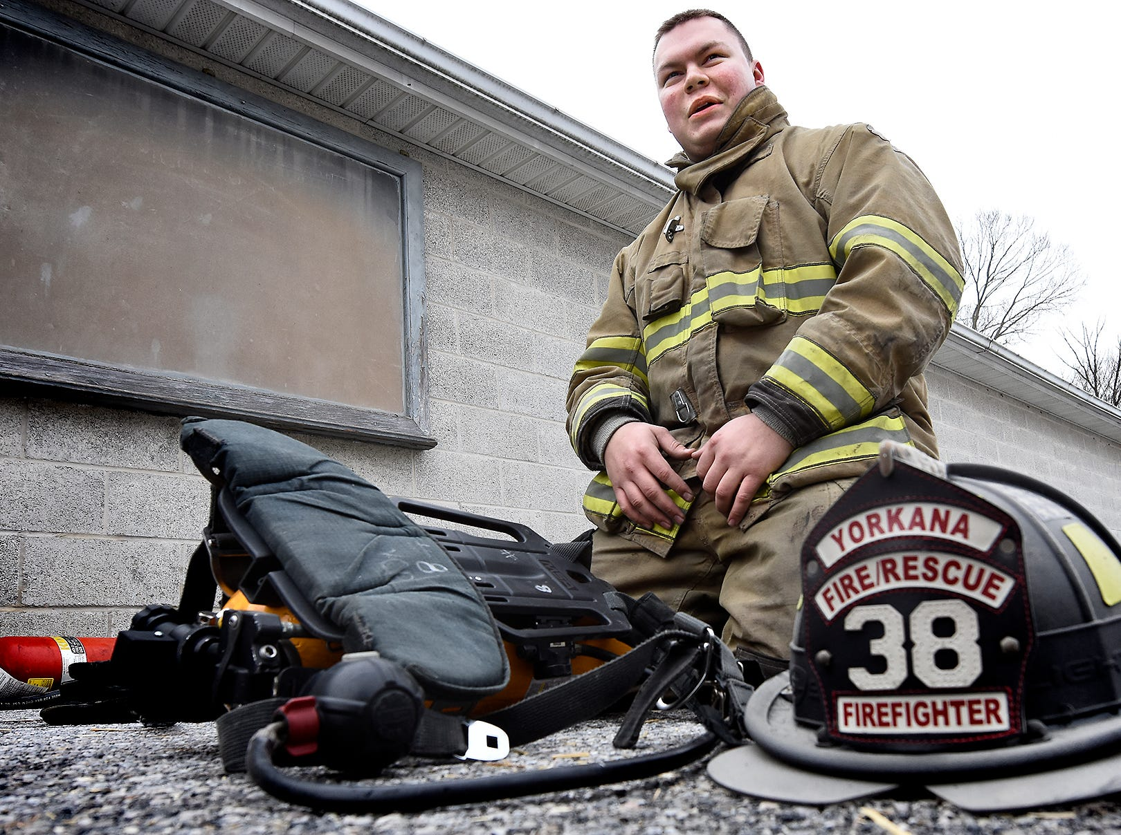 York County Prison mechanical maintenance employee Andrew Myers prepares his gear for a fire scenario at the York County Fire School during training there Friday, March 8, 2019. Members of the prison's 30-member Fire Emergency Response Team were completing a 40-hour fire training course at the school. The team is designed to control fire emergencies onsite prior to the arrival of firefighters. Myers serves as a volunteer with the Yorkana Community Fire Company. Bill Kalina photo