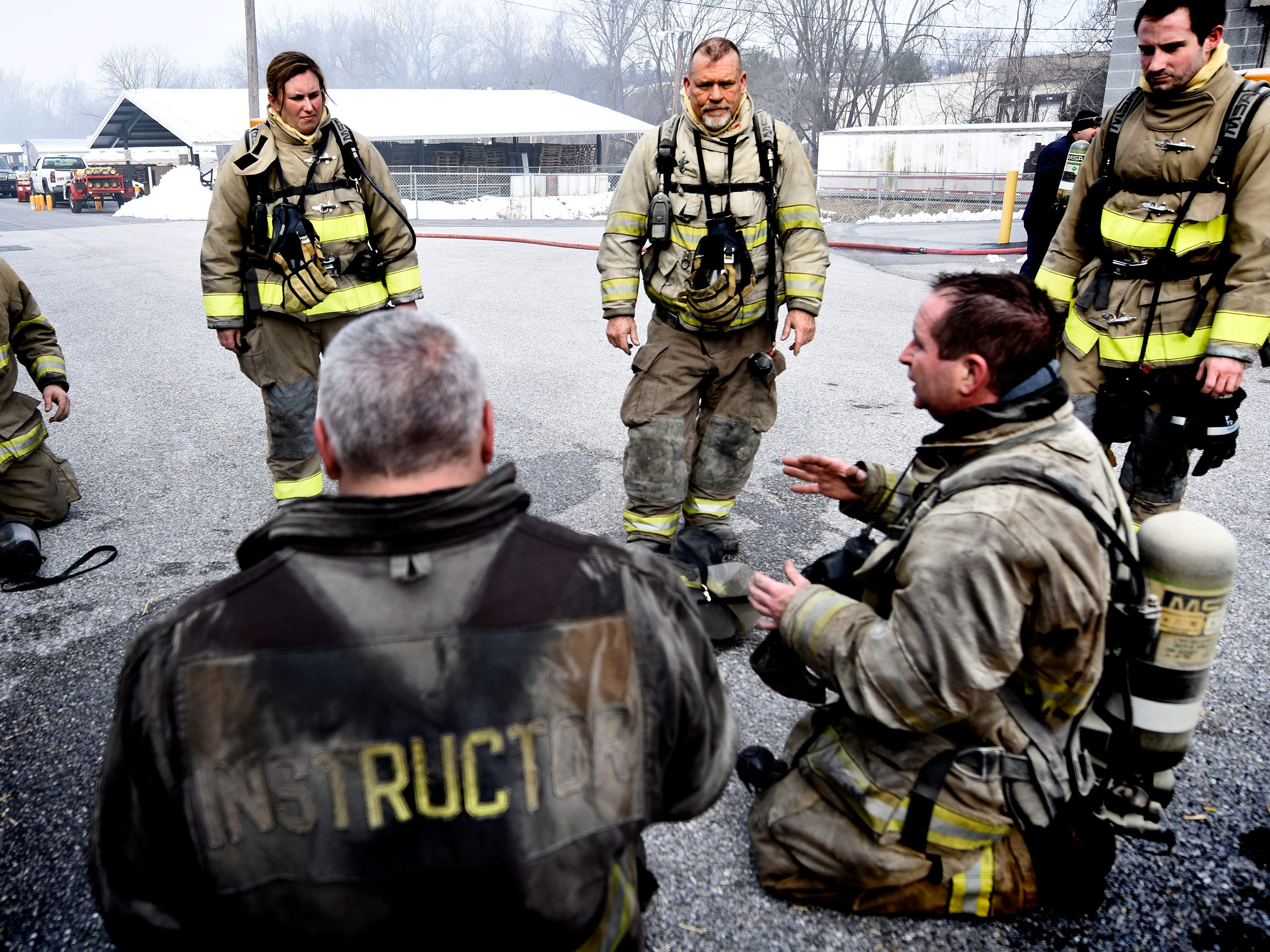 York County Fire School adjunct instructor Tom Rigling, right, talks with York County Prison workers during training at the school Friday, March 8, 2019. Members of the prison's 30-member Fire Emergency Response Team were completing a 40-hour fire training course there. Bill Kalina photo